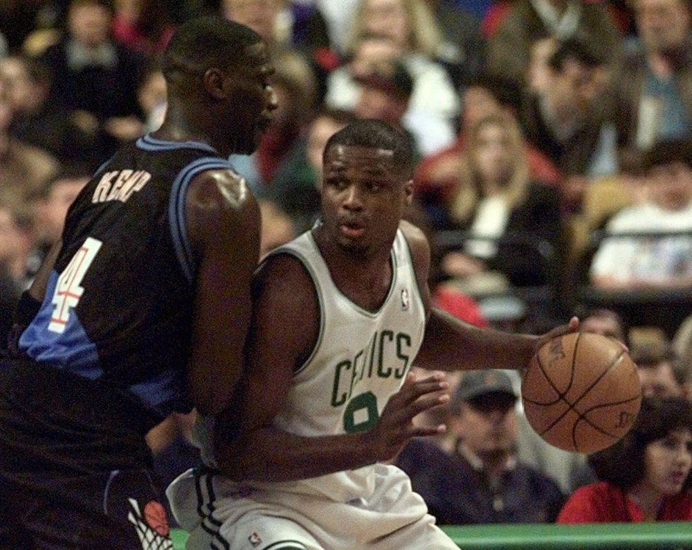 Boston Celtics forward Antoine Walker (8) looks for room to move around Cleveland Cavaliers forward Shawn Kemp (4) during first quarter action in Boston Friday night April 17, 1998. The Celtics, who did not make the playoffs, played their last home game of the 1997-98 season Friday