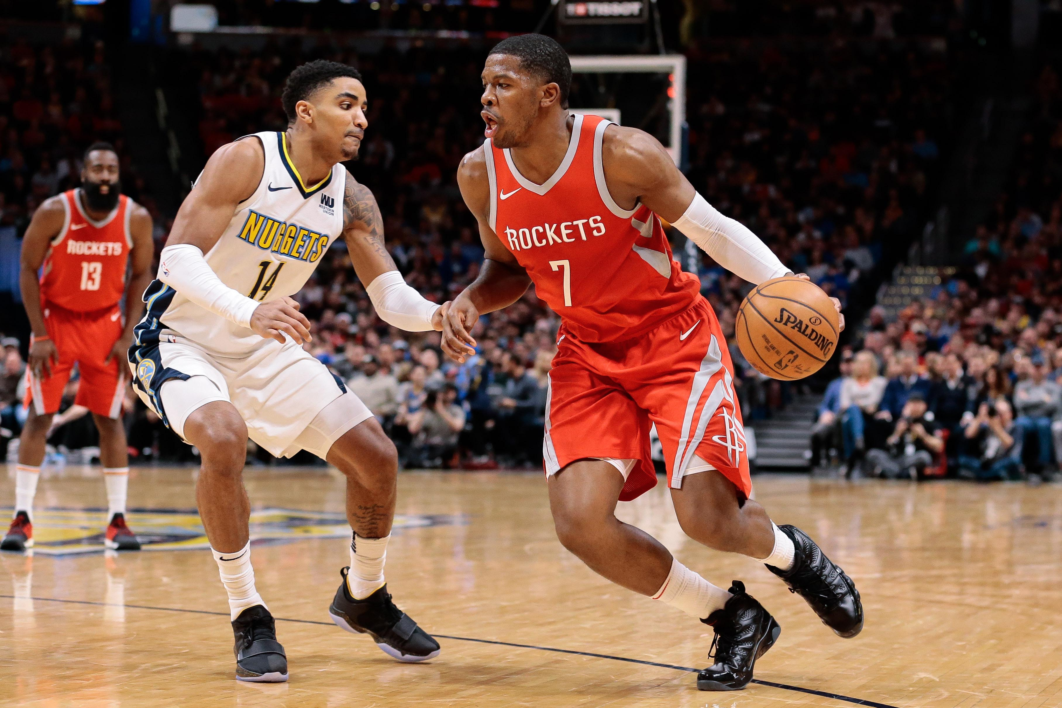 Feb 25, 2018; Denver, CO, USA; Denver Nuggets guard Gary Harris (14) guards Houston Rockets guard Joe Johnson (7) in the fourth quarter at the Pepsi Center.