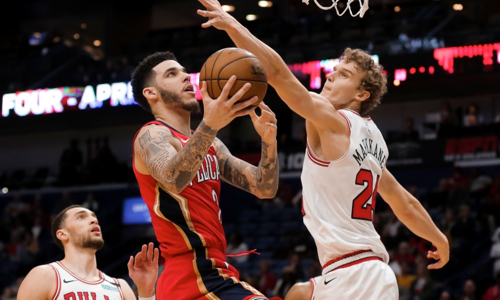 Jan 8, 2020; New Orleans, Louisiana, USA; New Orleans Pelicans guard Lonzo Ball (2) shoots over Chicago Bulls forward Lauri Markkanen (24) during the second half at the Smoothie King Center.