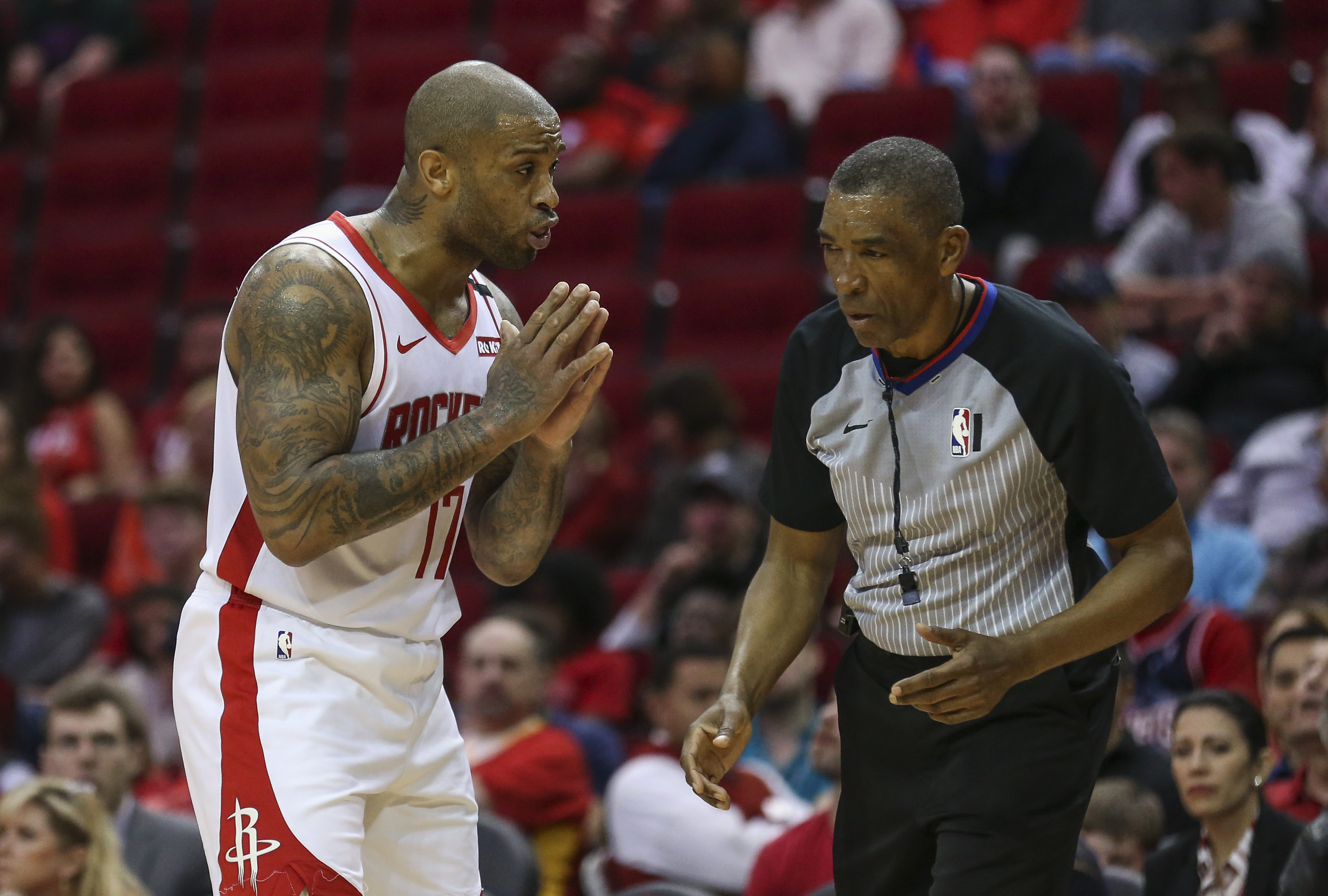 Jan 15, 2020; Houston, Texas, USA; Houston Rockets forward PJ Tucker (17) talks with an official during the fourth quarter against the Portland Trail Blazers at Toyota Center.