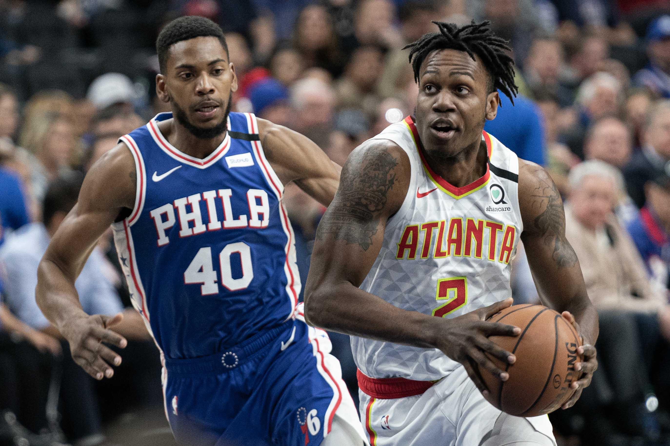 Feb 24, 2020; Philadelphia, Pennsylvania, USA; Atlanta Hawks guard Treveon Graham (2) drives against Philadelphia 76ers forward Glenn Robinson III (40) during the first quarter at Wells Fargo Center.