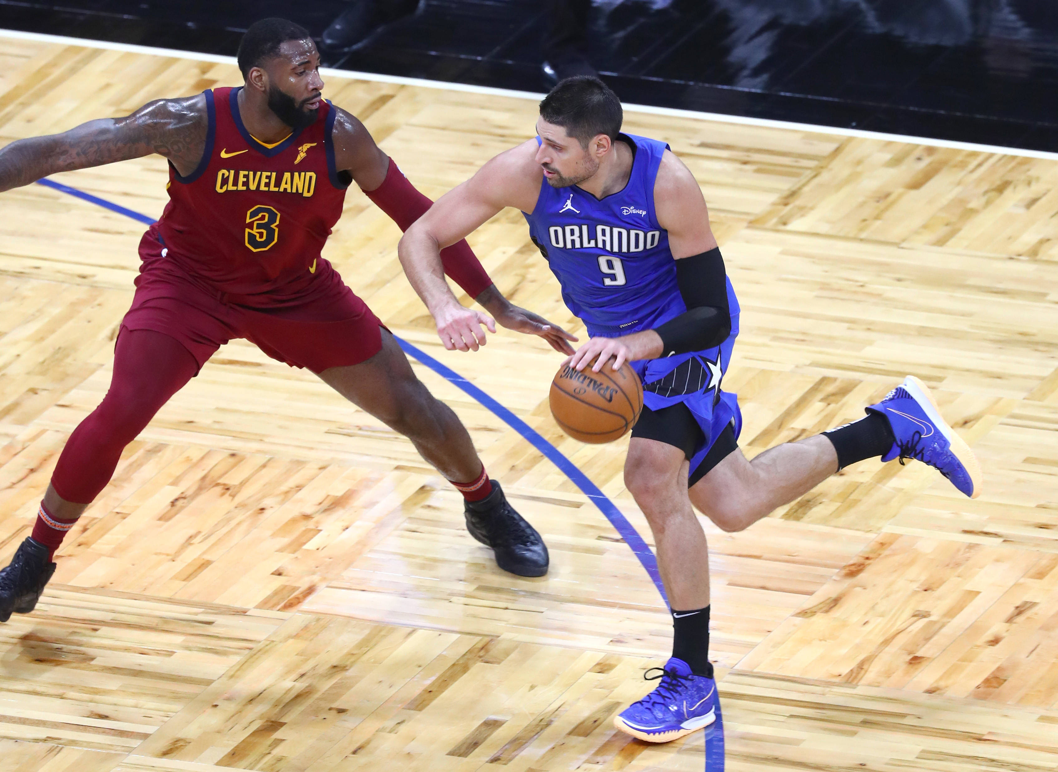 Jan 6, 2021; Orlando, Florida, USA; Orlando Magic center Nikola Vucevic (9) drives to the basket as Cleveland Cavaliers center Andre Drummond (3) defends during the first quarter at Amway Center.