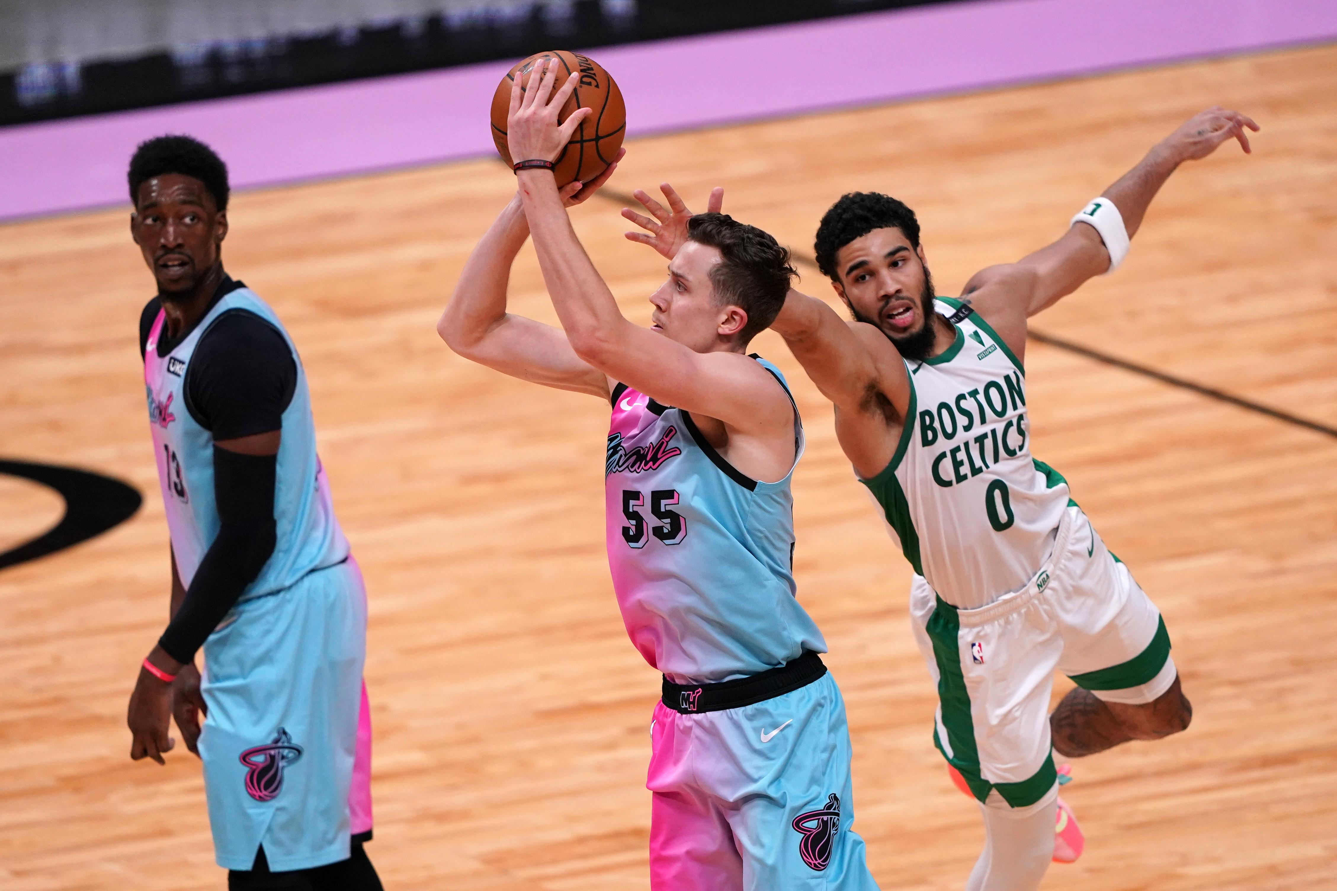 Jan 6, 2021; Miami, Florida, USA; Miami Heat forward Duncan Robinson (55) attempts a three point shot on Boston Celtics forward Jayson Tatum (0) during the second half at American Airlines Arena.
