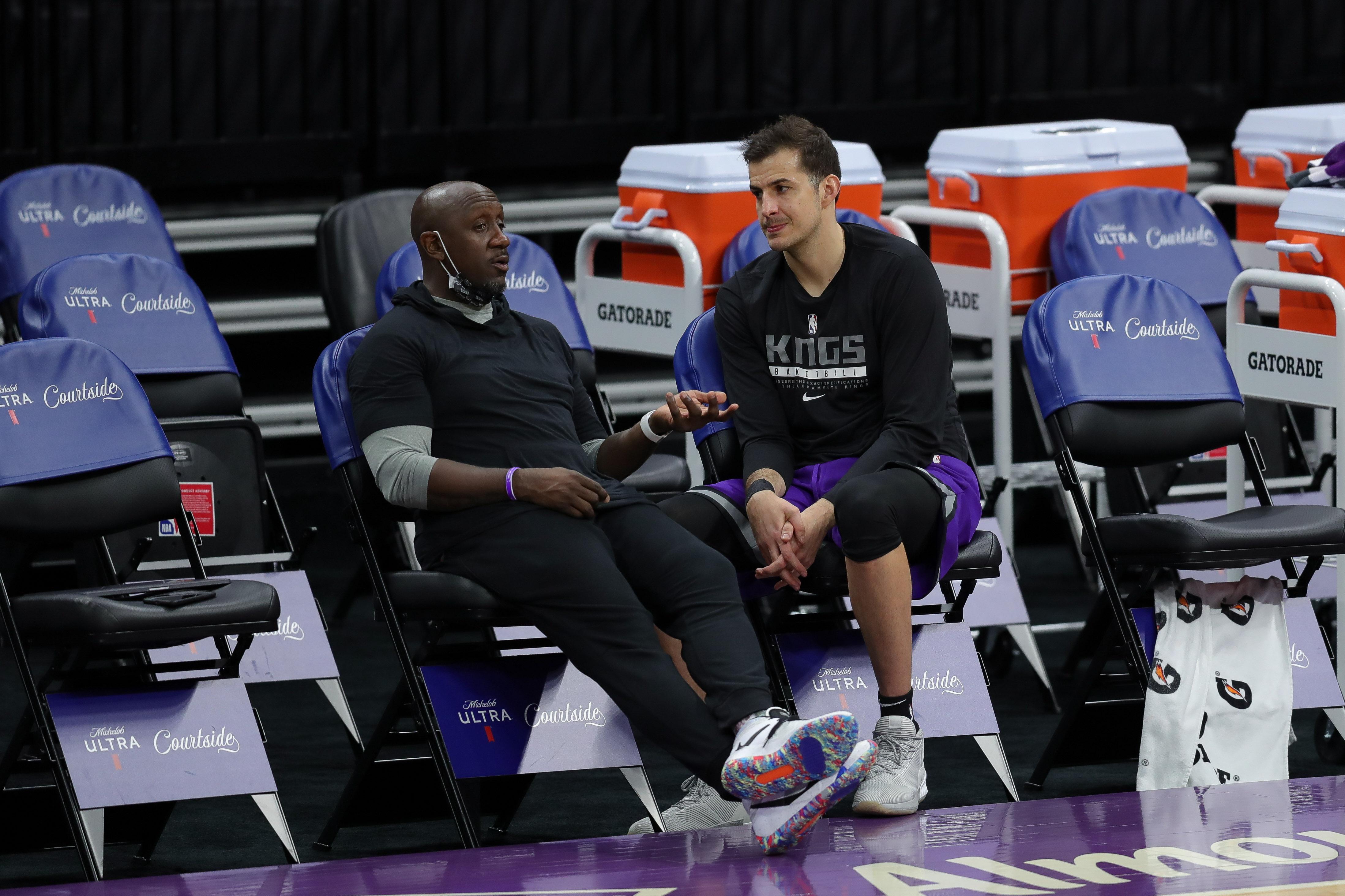 Jan 8, 2021; Sacramento, California, USA; Sacramento Kings assistant coach Bobby Jackson talks with forward Nemanja Bjelica (8) before the game against the Toronto Raptors at Golden 1 Center.