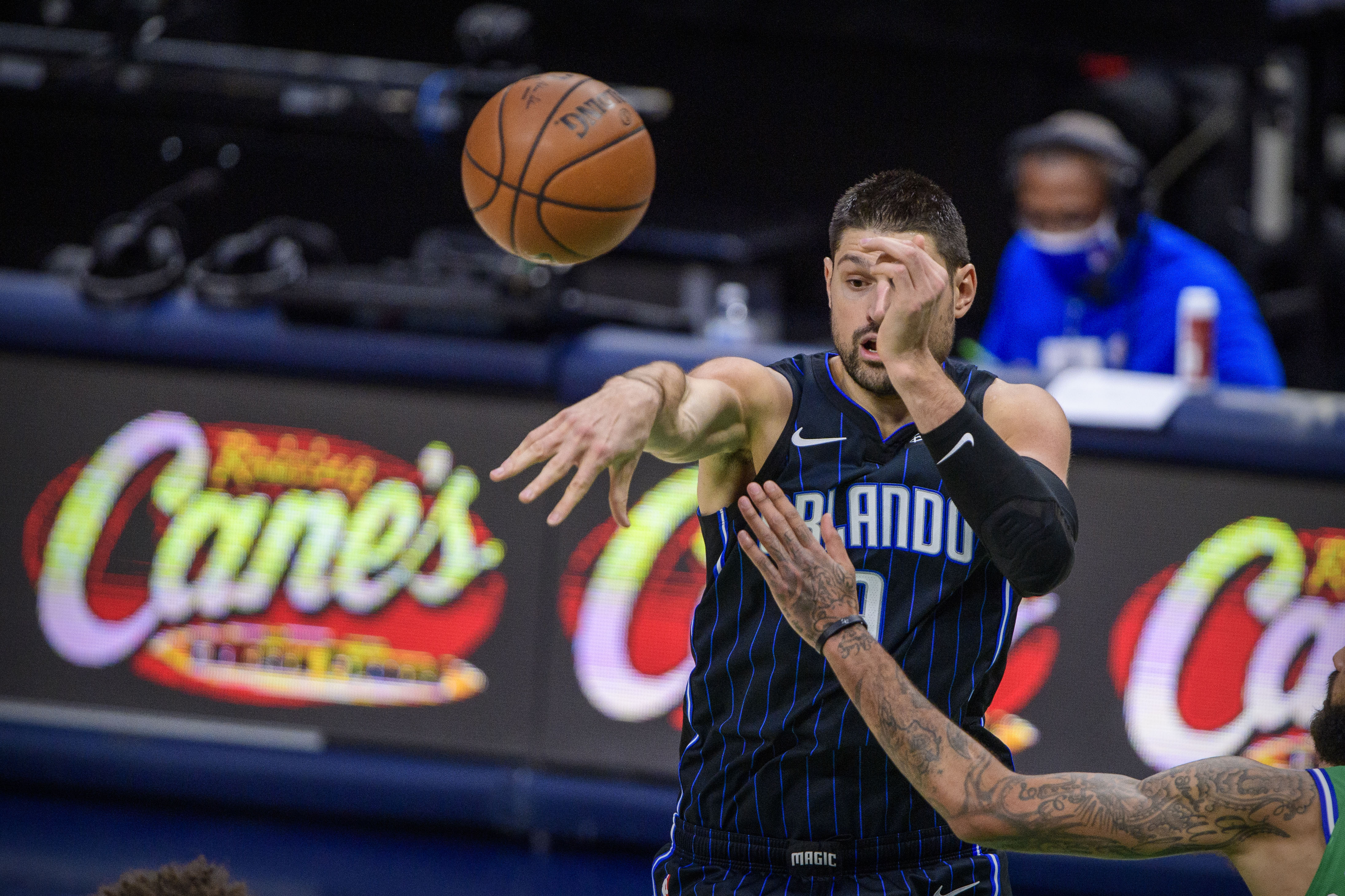 Jan 9, 2021; Dallas, Texas, USA; Orlando Magic center Nikola Vucevic (9) in action during the game between the Dallas Mavericks and the Orlando Magic at the American Airlines Center. Mandatory Credit: