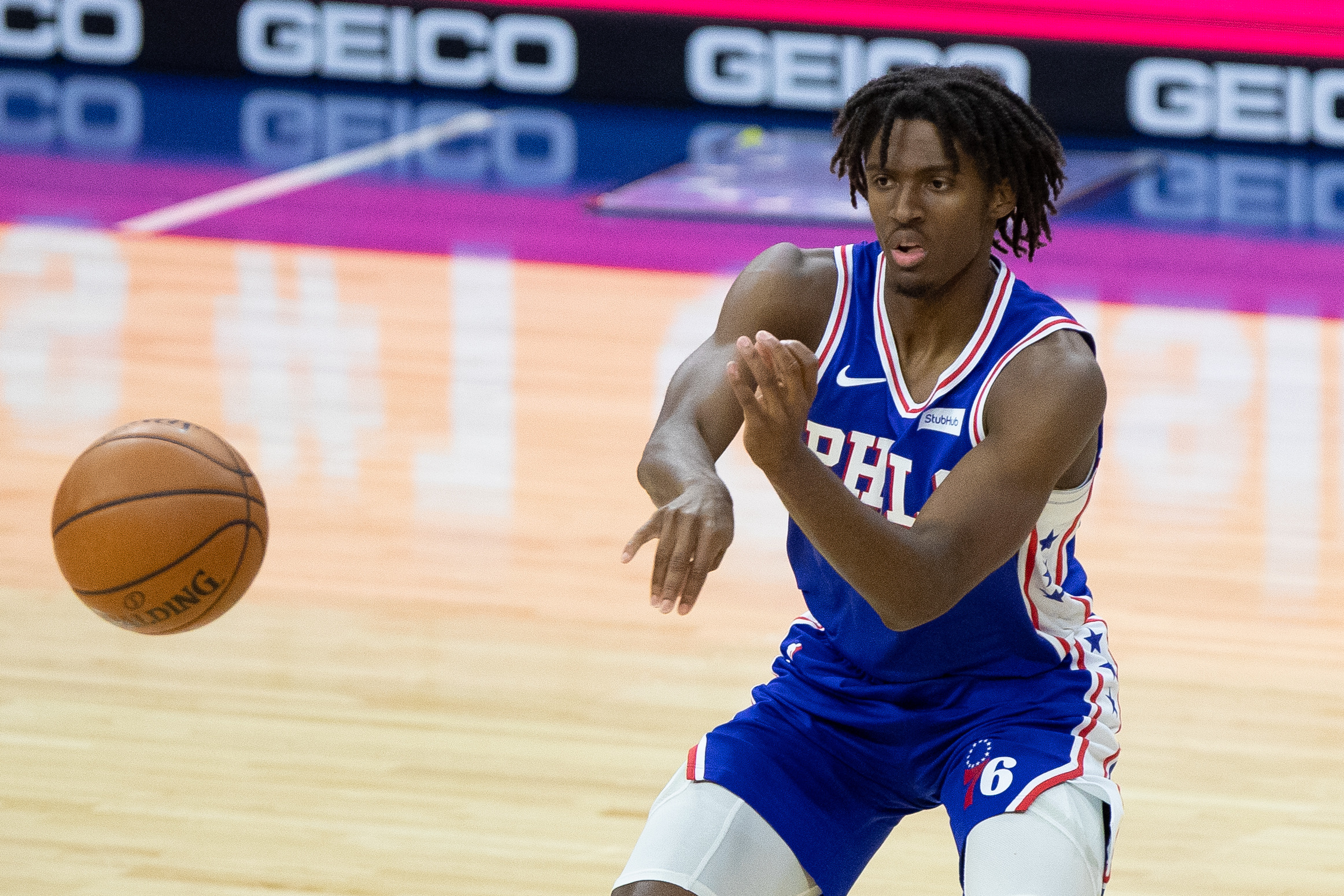Jan 12, 2021; Philadelphia, Pennsylvania, USA; Philadelphia 76ers guard Tyrese Maxey (0) passes the ball against the Miami Heat during the third quarter at Wells Fargo Center.