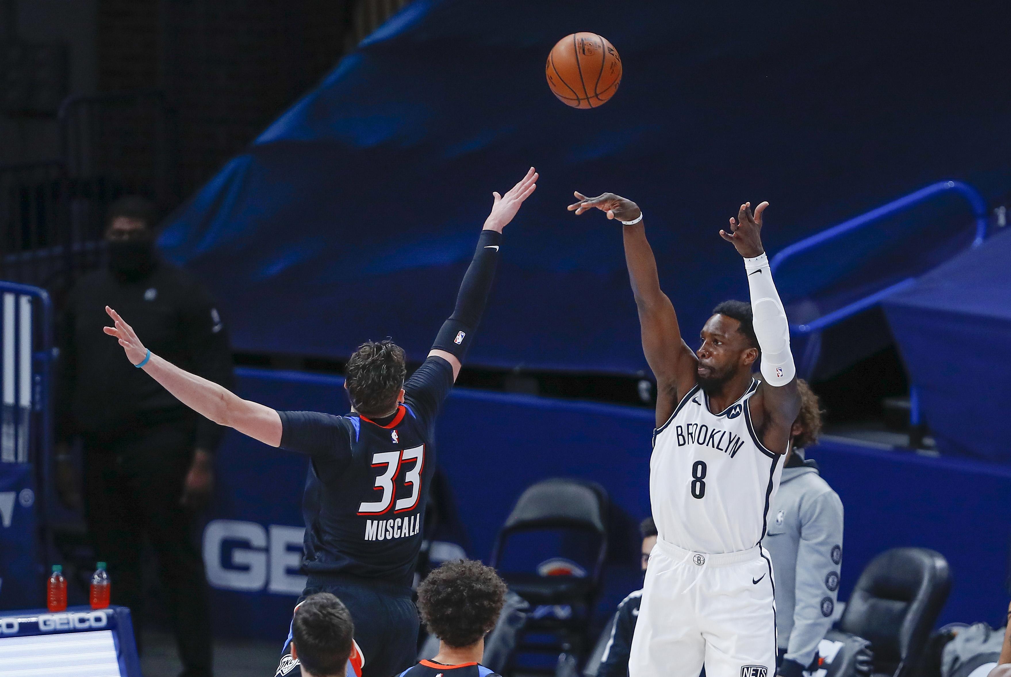 Jan 29, 2021; Oklahoma City, Oklahoma, USA; Brooklyn Nets forward Jeff Green (8) shoots a three point basket against Oklahoma City Thunder center Mike Muscala (33) during the first half at Chesapeake Energy Arena.