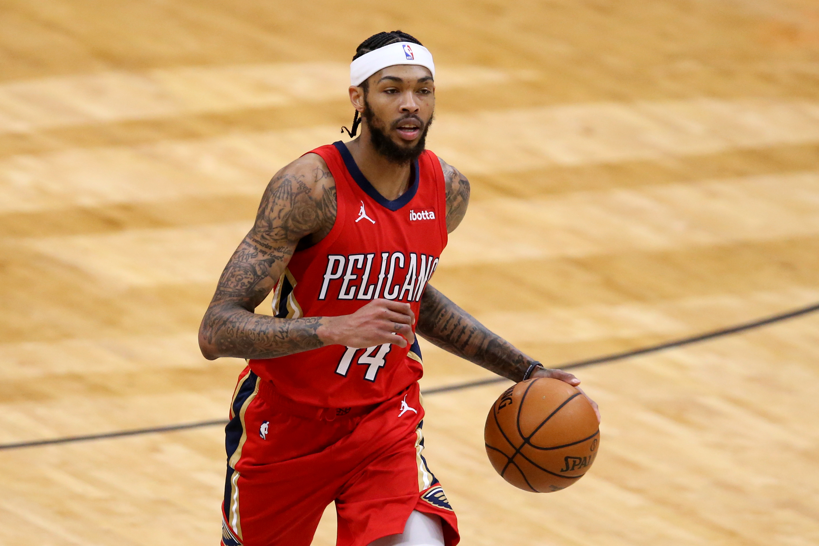 Jan 30, 2021; New Orleans, Louisiana, USA; New Orleans Pelicans forward Brandon Ingram (14) dribbles up court in the third quarter against the Houston Rockets at the Smoothie King Center.