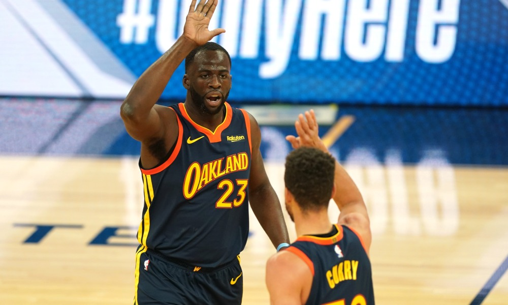 Feb 2, 2021; San Francisco, California, USA; Golden State Warriors forward Draymond Green (23) congratulates guard Stephen Curry (30) during the first quarter against the Boston Celtics at Chase Center.
