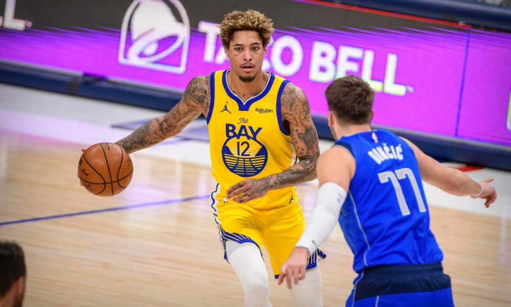 Feb 4, 2021; Dallas, Texas, USA; Dallas Mavericks guard Luka Doncic (77) guards Golden State Warriors guard Kelly Oubre Jr. (12) during the second half at the American Airlines Center.