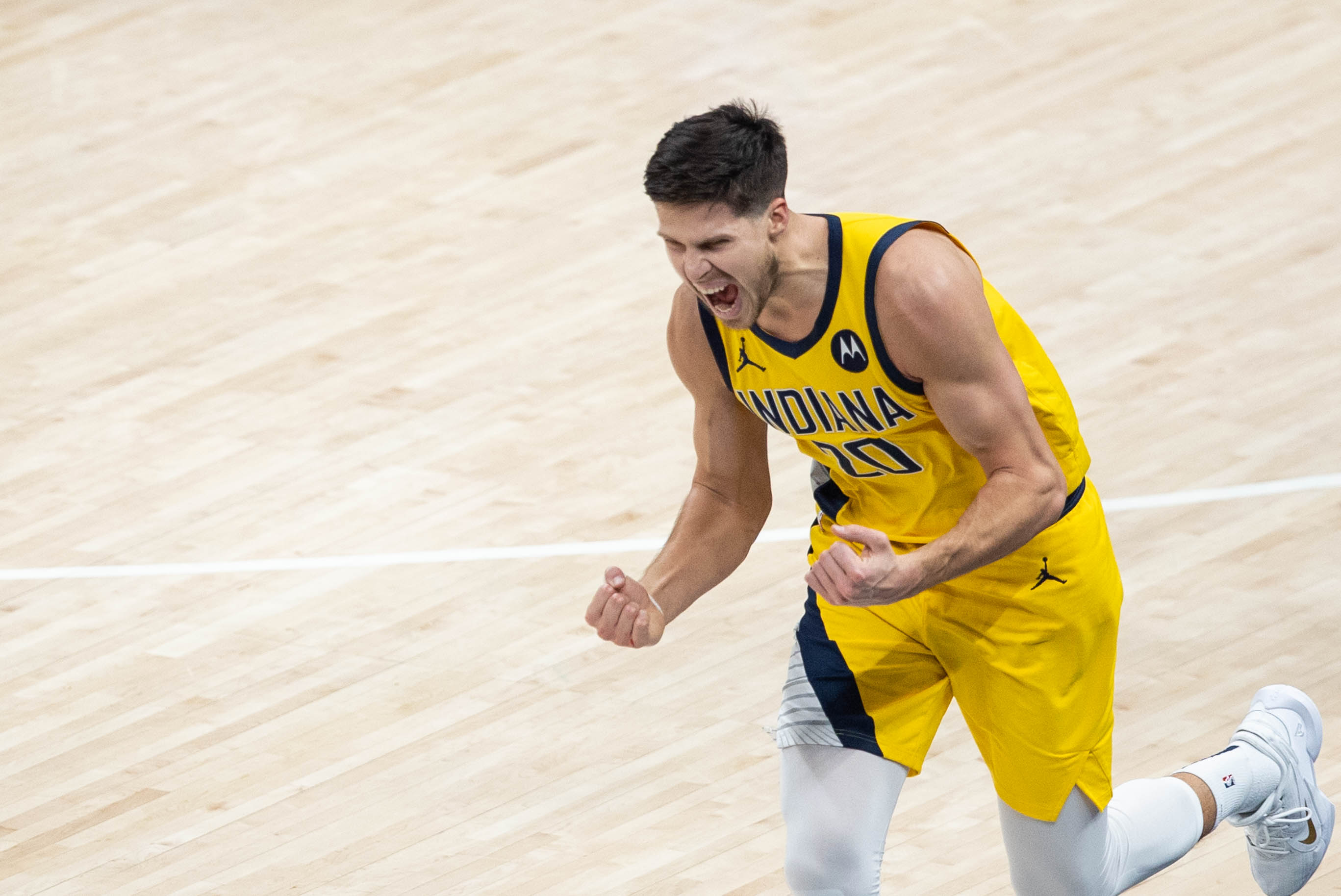 Feb 5, 2021; Indianapolis, Indiana, USA; Indiana Pacers forward Doug McDermott (20) celebrates a made three point basket in the fourth quarter against the New Orleans Pelicans at Bankers Life Fieldhouse.