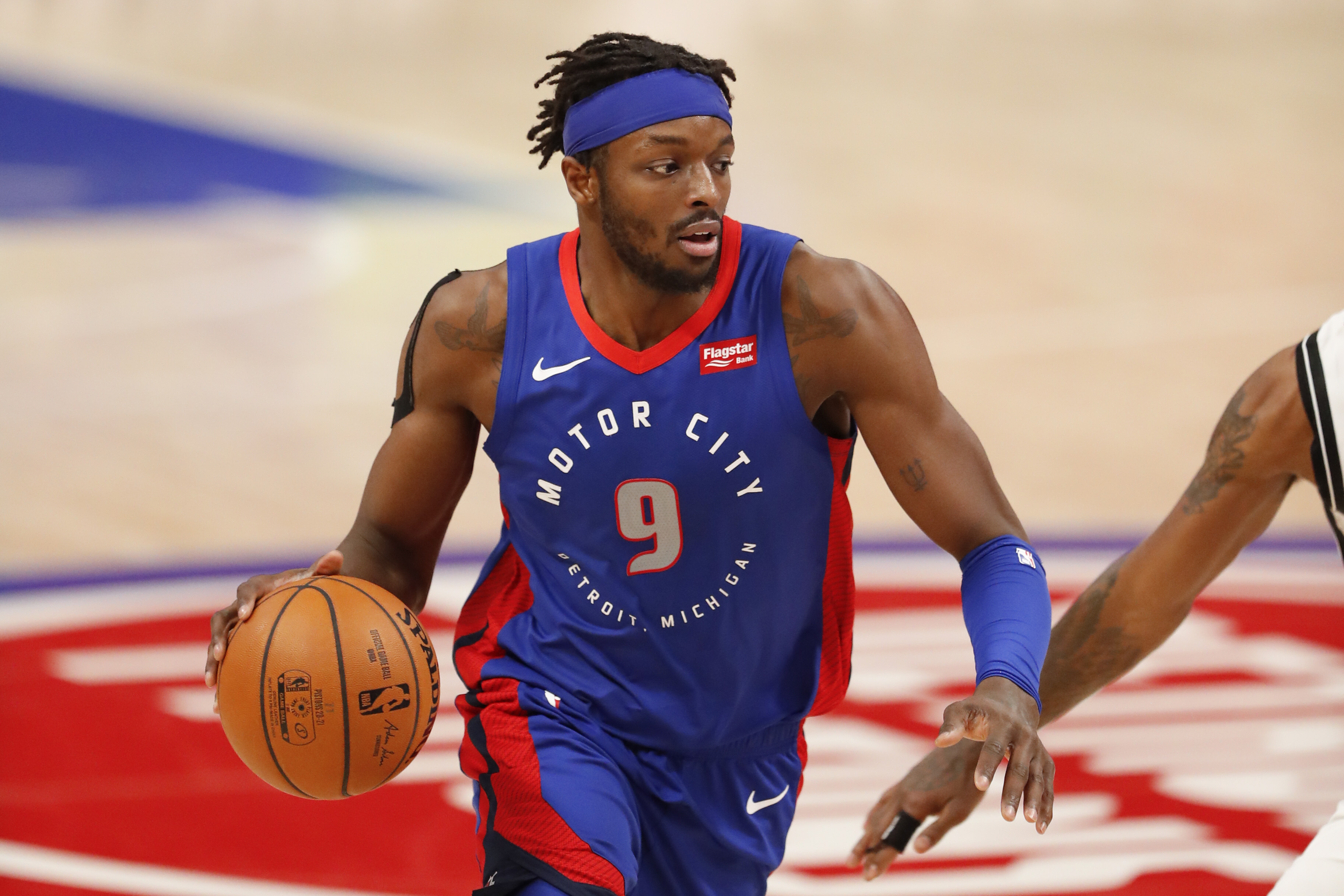 Feb 9, 2021; Detroit, Michigan, USA; Detroit Pistons forward Jerami Grant (9) dribbles the ball during the third quarter against the Brooklyn Nets at Little Caesars Arena.