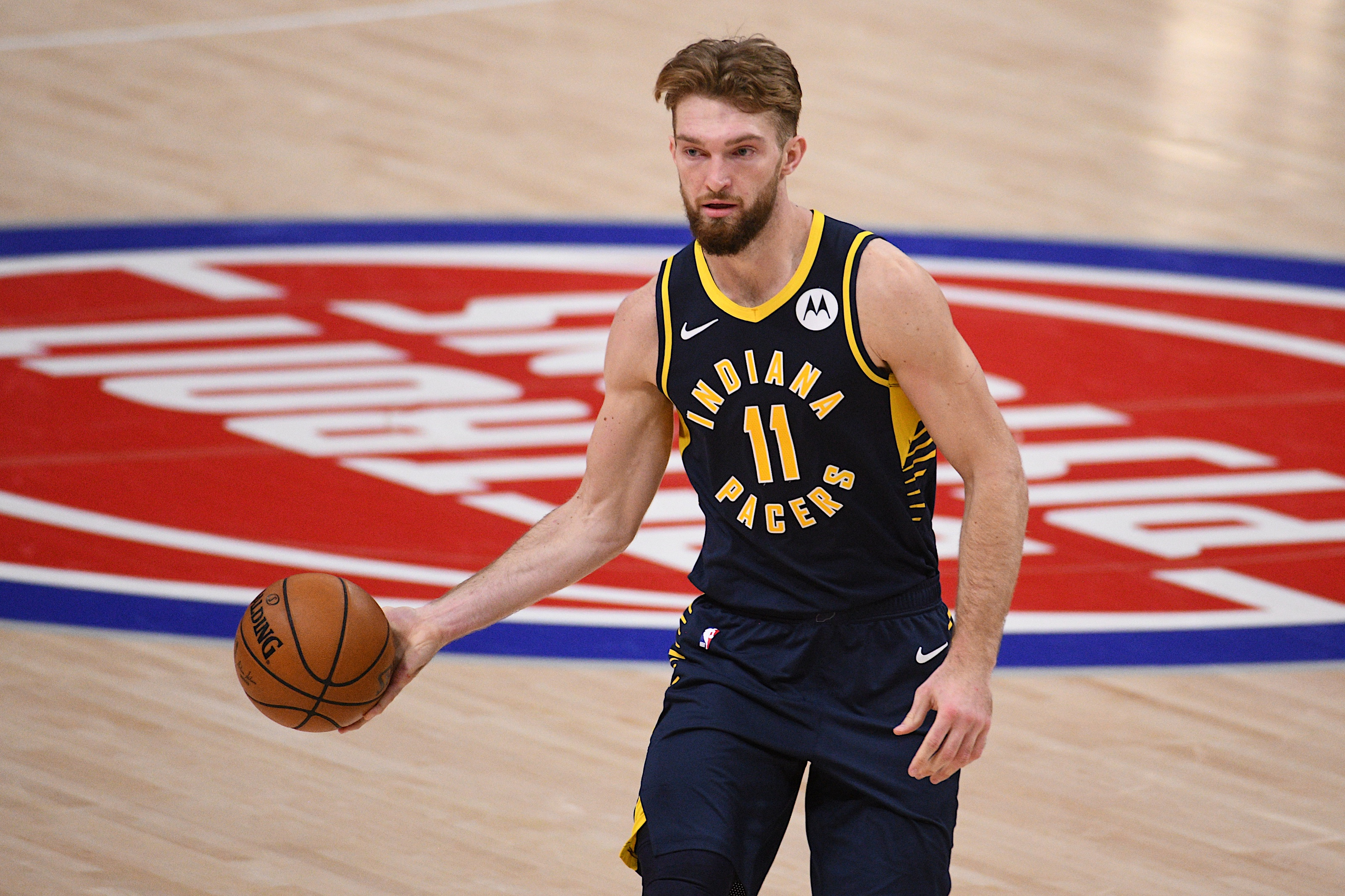 Feb 11, 2021; Detroit, Michigan, USA; Indiana Pacers forward Domantas Sabonis (11) controls the ball against the Detroit Pistons during the third quarter at Little Caesars Arena.