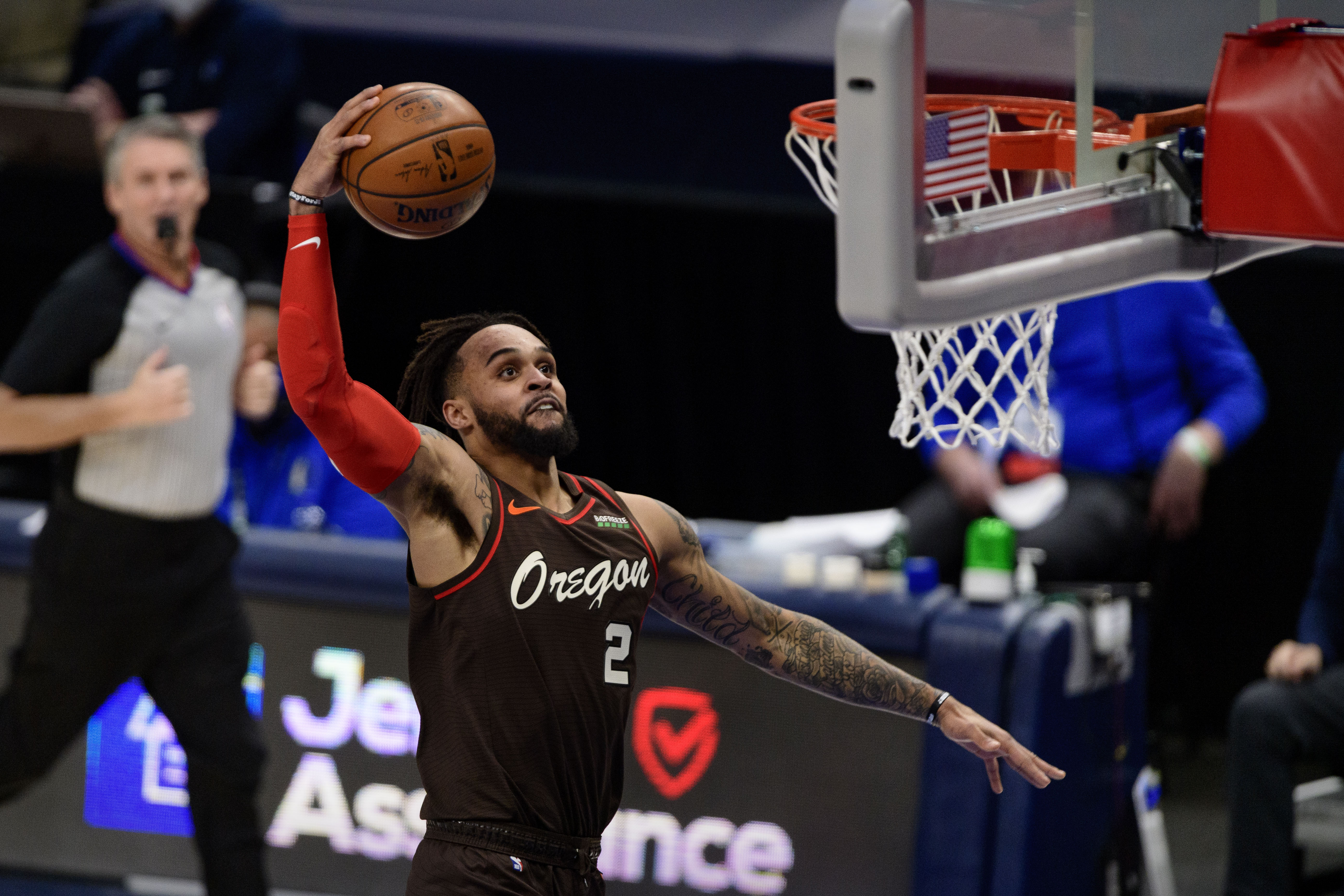 Feb 14, 2021; Dallas, Texas, USA; Portland Trail Blazers guard Gary Trent Jr. (2) dunks the ball against the Dallas Mavericks during the second half at the American Airlines Center.