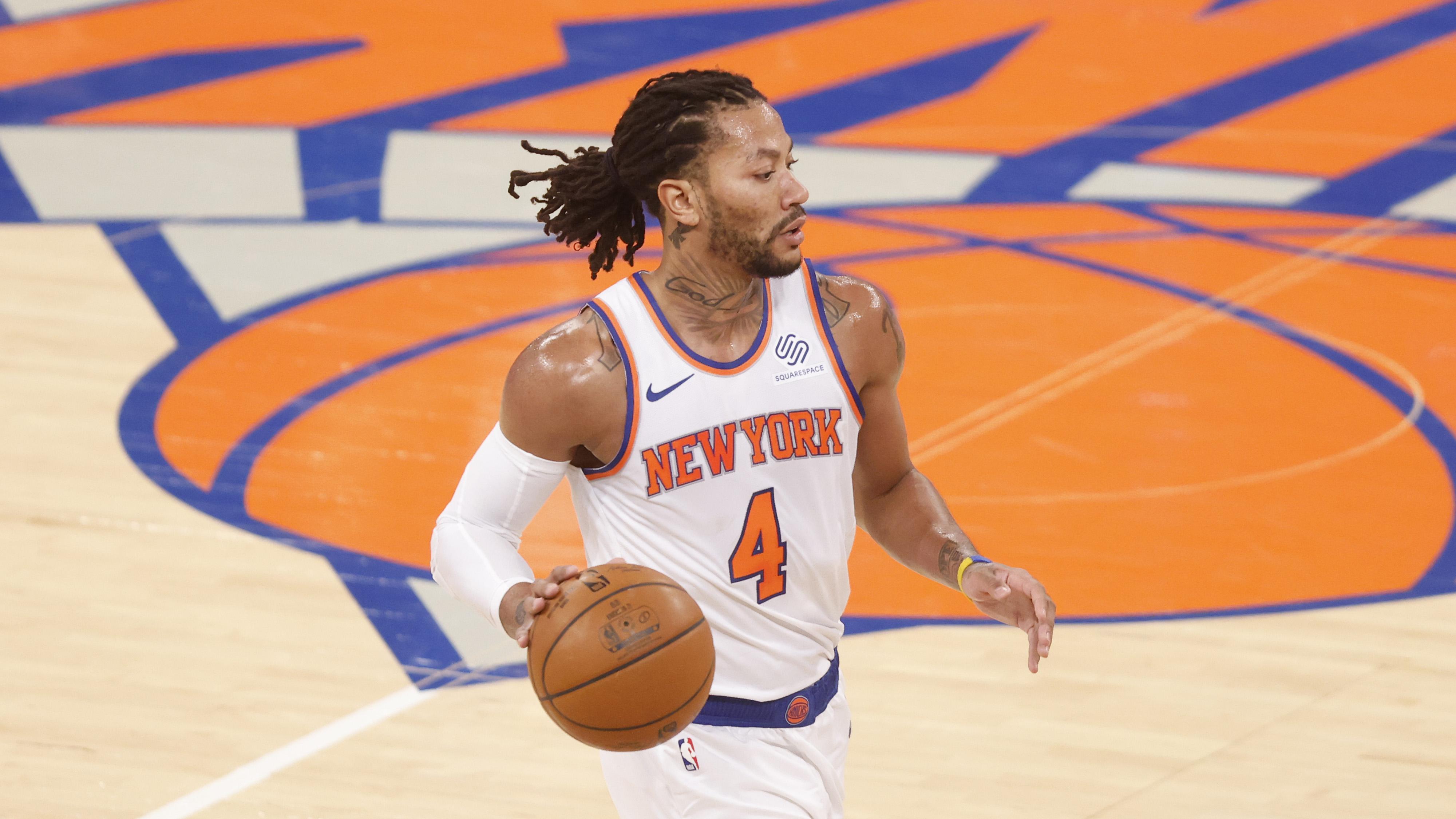 Feb 15, 2021; New York, New York, USA; New York Knicks' Derrick Rose (4) advances the ball against the Atlanta Hawks during the second quarter at Madison Square Garden.