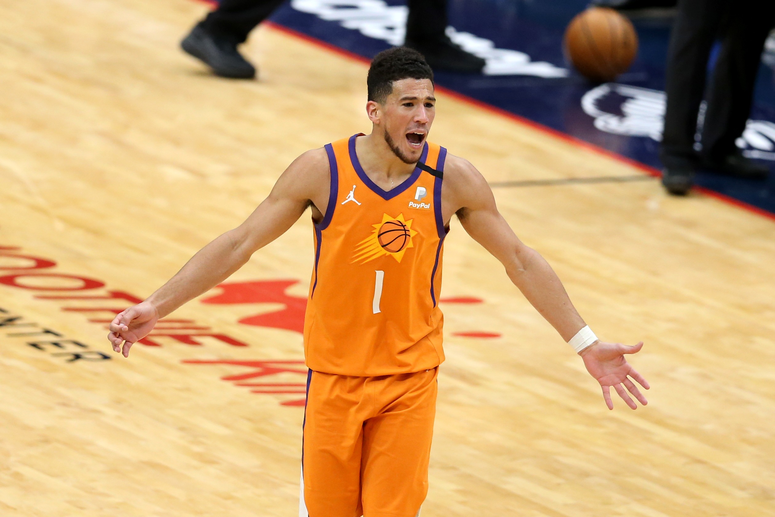 Feb 19, 2021; New Orleans, Louisiana, USA; Phoenix Suns guard Devin Booker (1) reacts after being called for a technical foul in the third quarter against the New Orleans Pelicans at the Smoothie King Center.