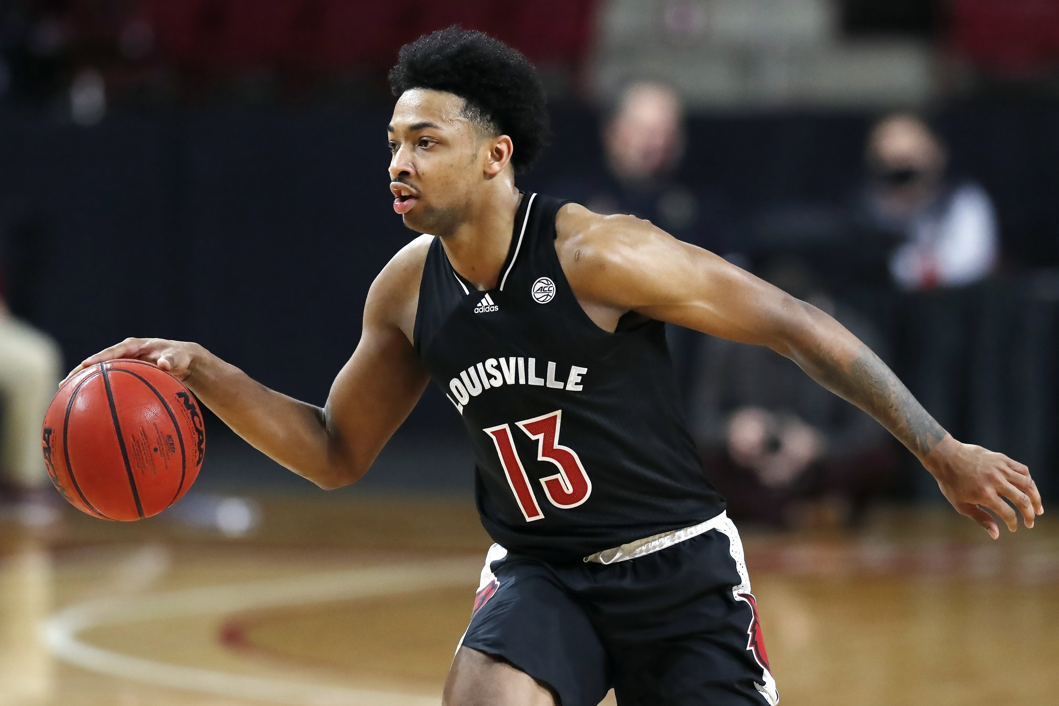 Louisville's David Johnson plays against Boston College during the first half of an NCAA college basketball game, Saturday, Jan. 2, 2021, in Boston.