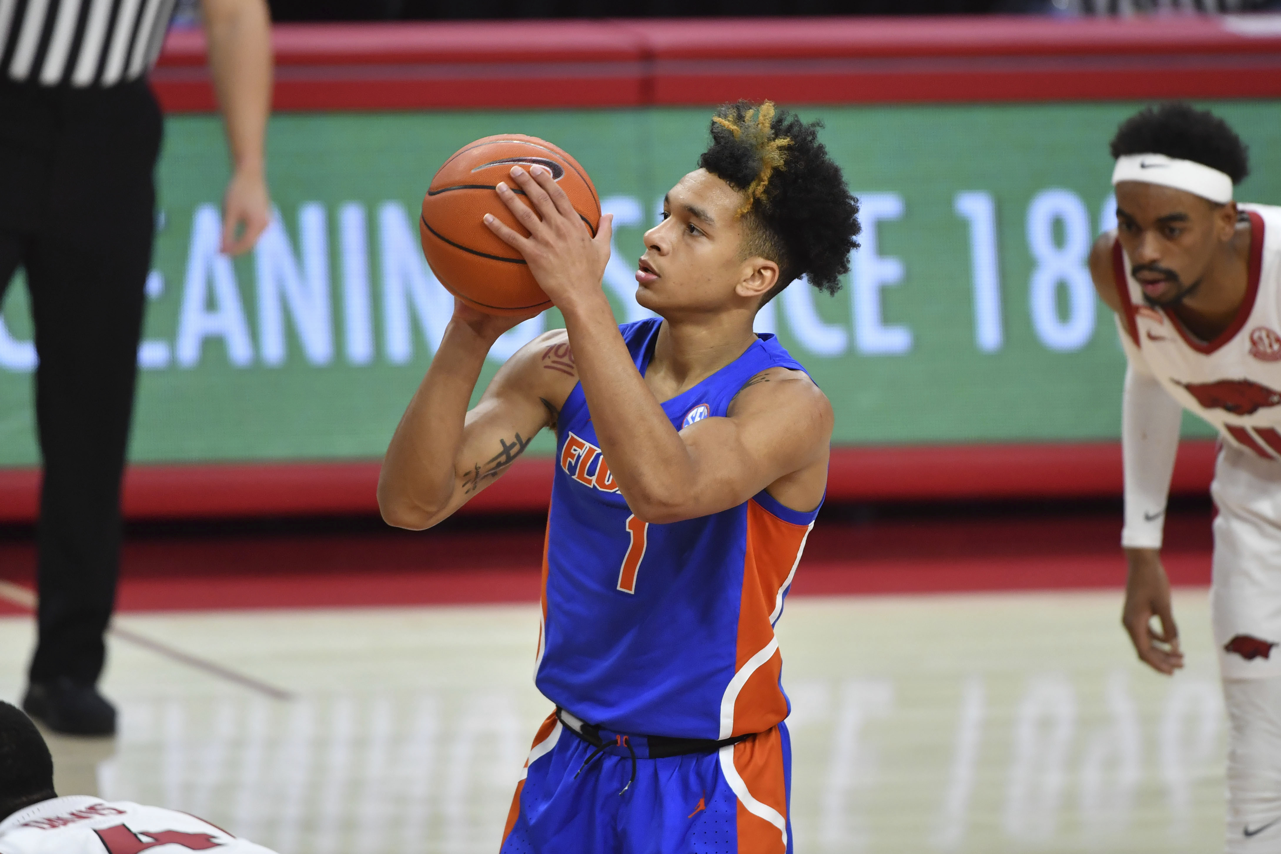 Florida guard Tre Mann (1) shoots a free throw against Arkansas during the second half of an NCAA college basketball game in Fayetteville, Ark. Tuesday, Feb. 16, 2021.