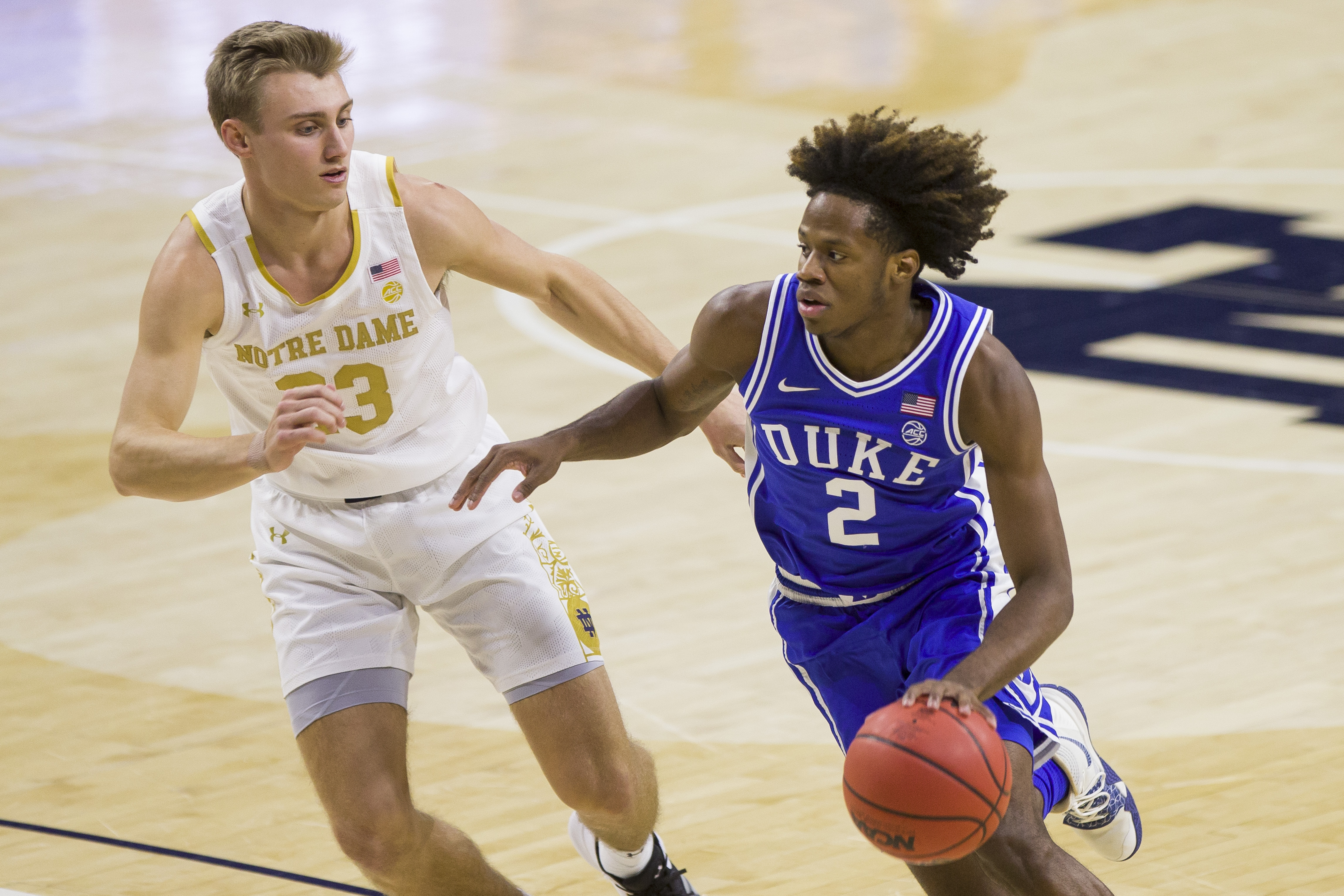 Duke's DJ Steward (2) drives by Notre Dame's Dane Goodwin (23) during the first half of an NCAA college basketball game Wednesday, Dec. 16, 2020, in South Bend, Ind.
