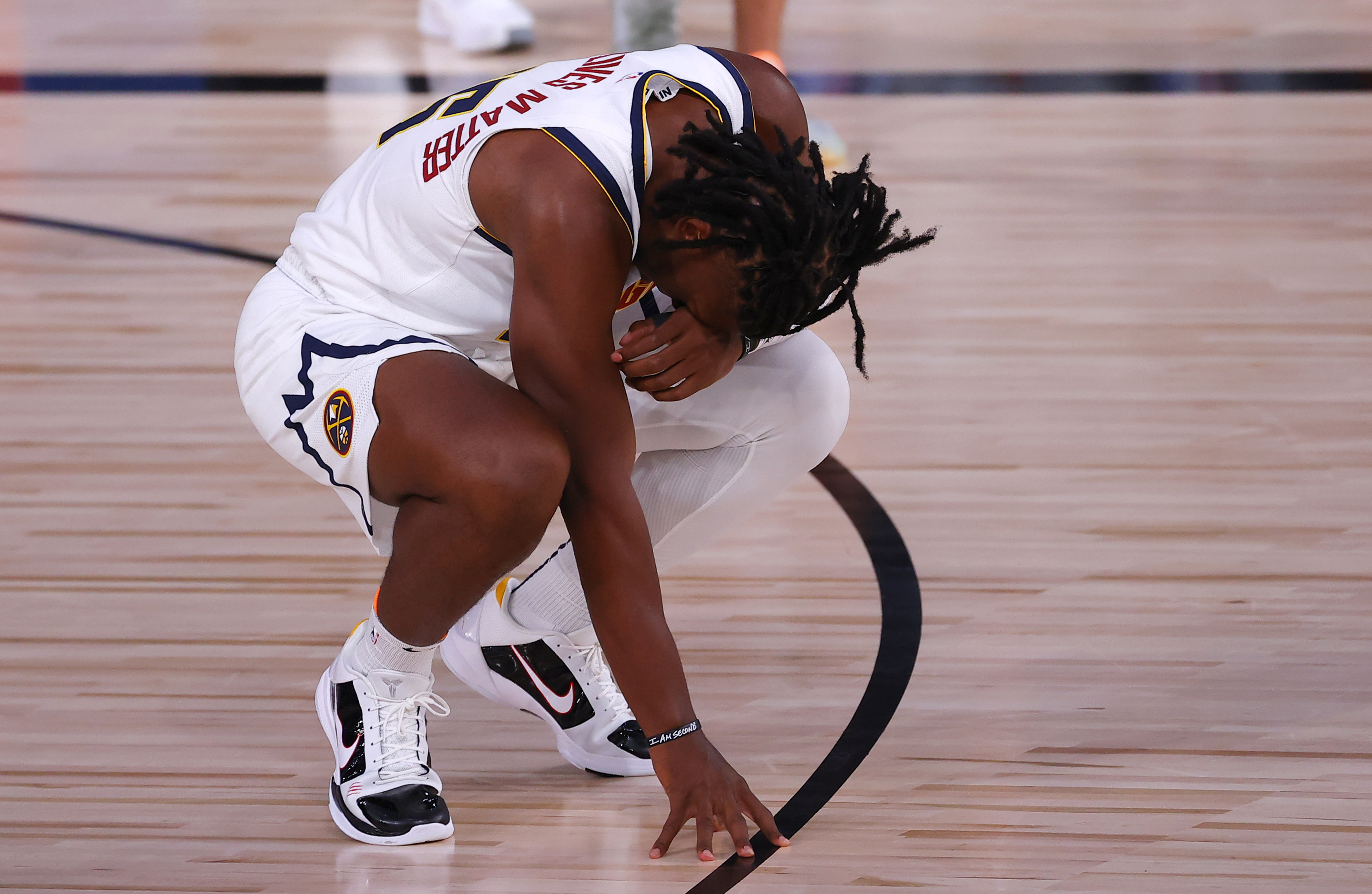 Aug 6, 2020; Lake Buena Vista, Florida, USA; Tyler Cook #25 of the Denver Nuggets reacts to their 125-115 loss to the Portland Trail Blazers at Visa Athletic Center at ESPN Wide World Of Sports Complex on August 06, 2020 in Lake Buena Vista, Florida.