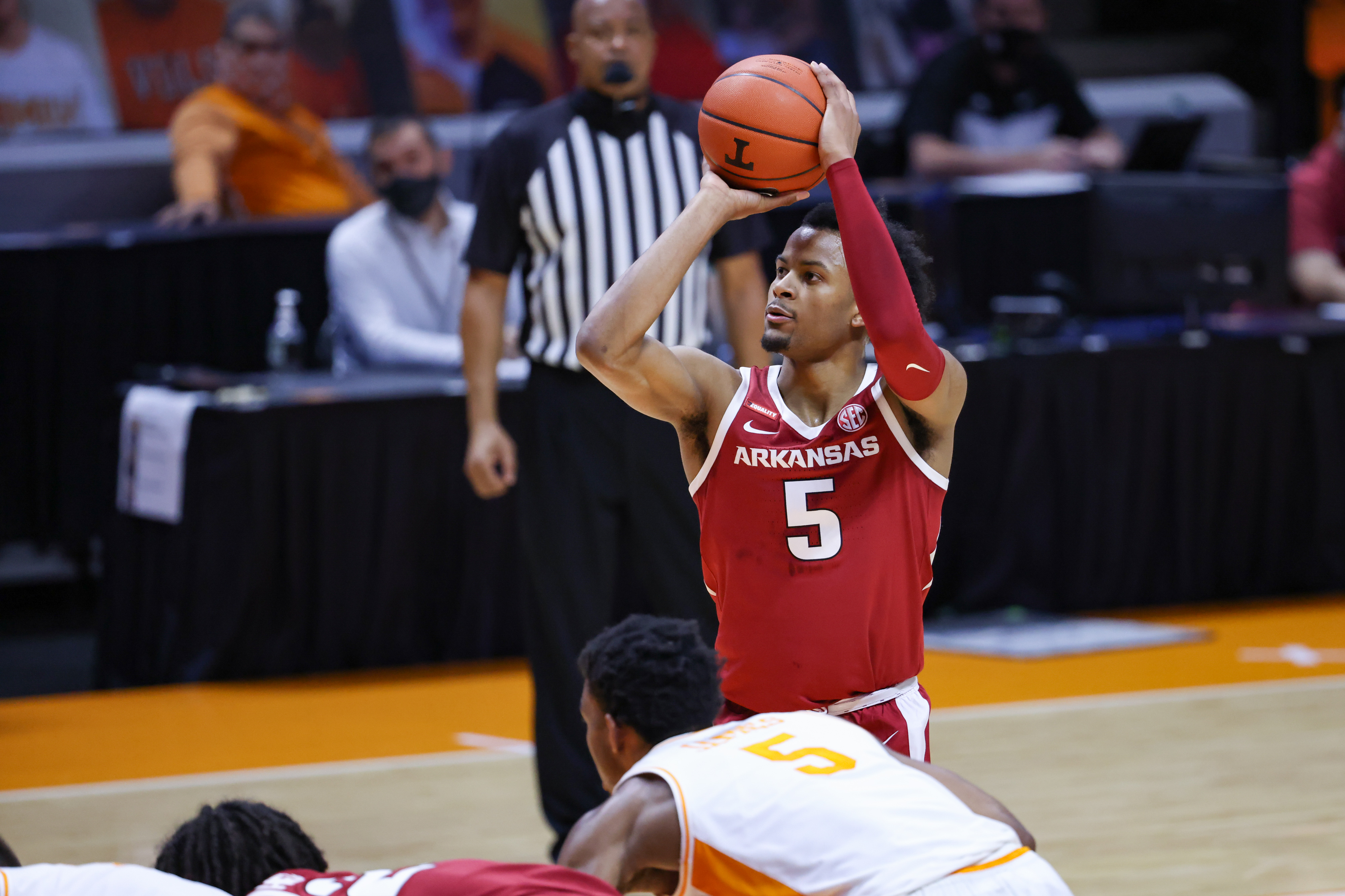 Jan 6, 2021; Knoxville, Tennessee, USA; Arkansas Razorbacks guard Moses Moody (5) shoots a free throw against the Tennessee Volunteers during the first half at Thompson-Boling Arena.