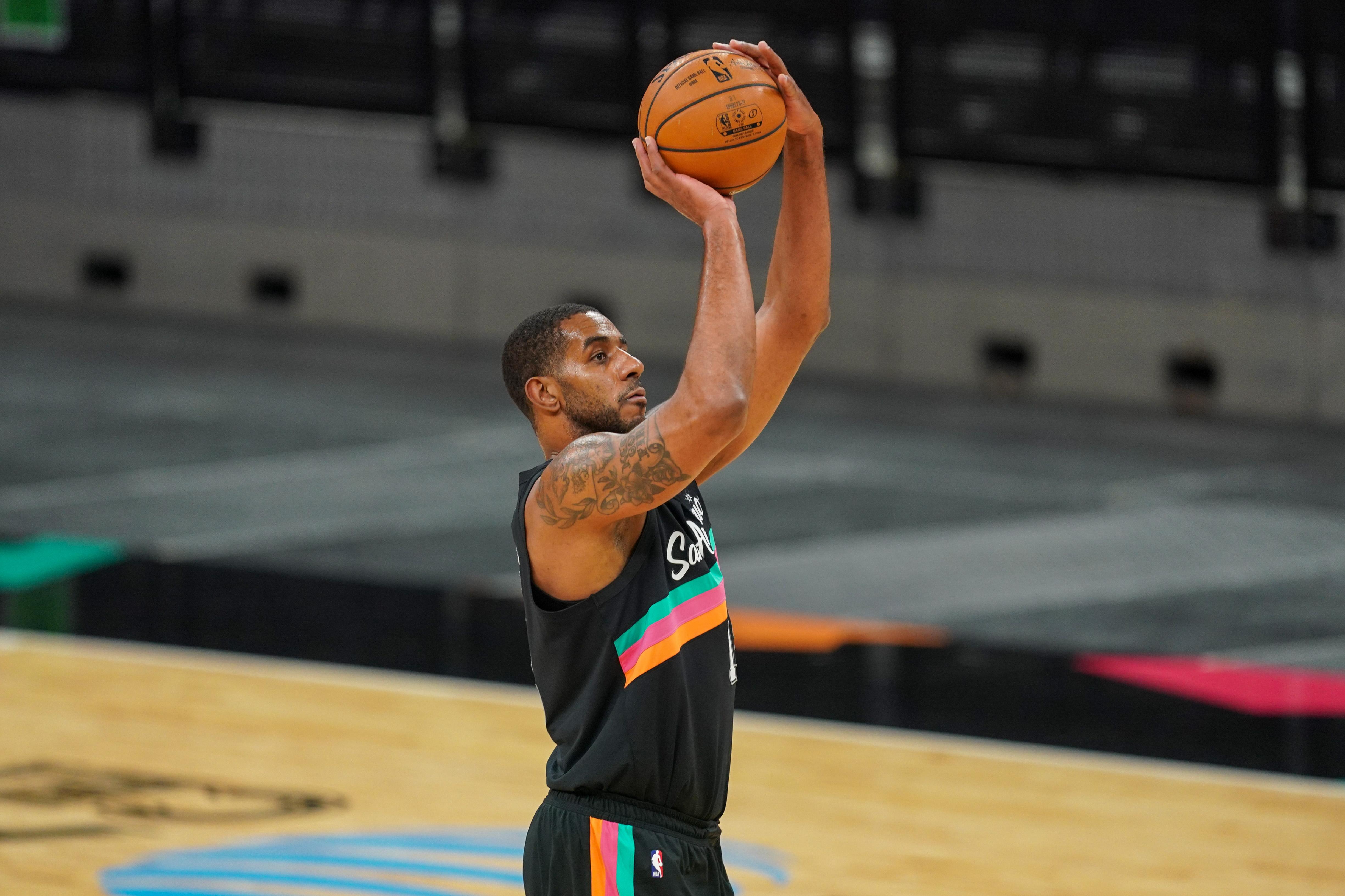 Jan 22, 2021; San Antonio, Texas, USA; San Antonio Spurs center LaMarcus Aldridge (12) shoots in the first half against the Dallas Mavericks at the AT&T Center.