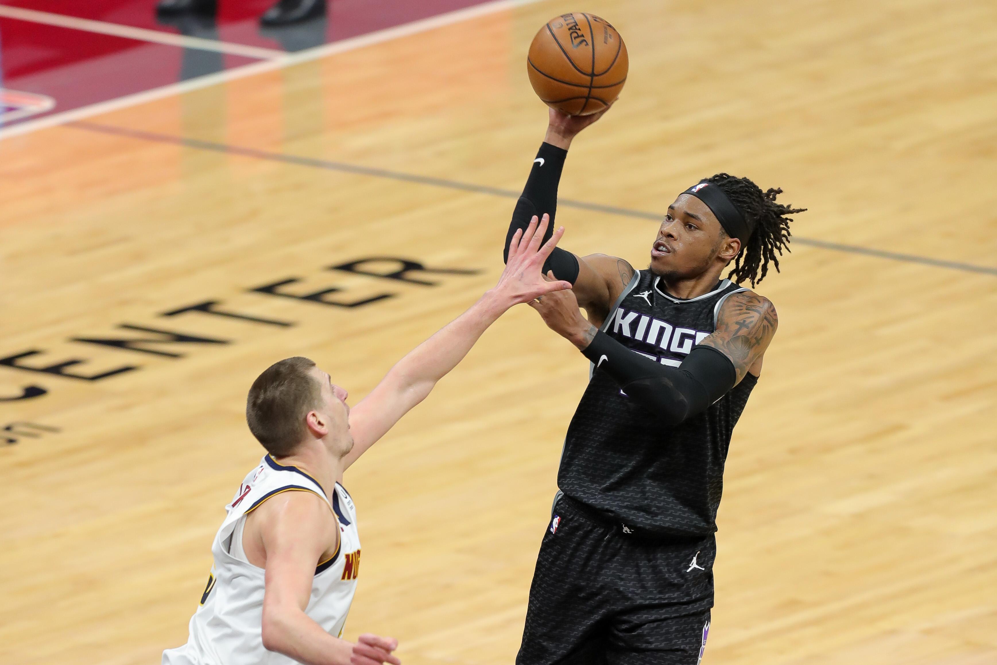 Feb 6, 2021; Sacramento, California, USA; Sacramento Kings center Richaun Holmes (22) shoots the ball over Denver Nuggets center Nikola Jokic (15) during the third quarter at Golden 1 Center.