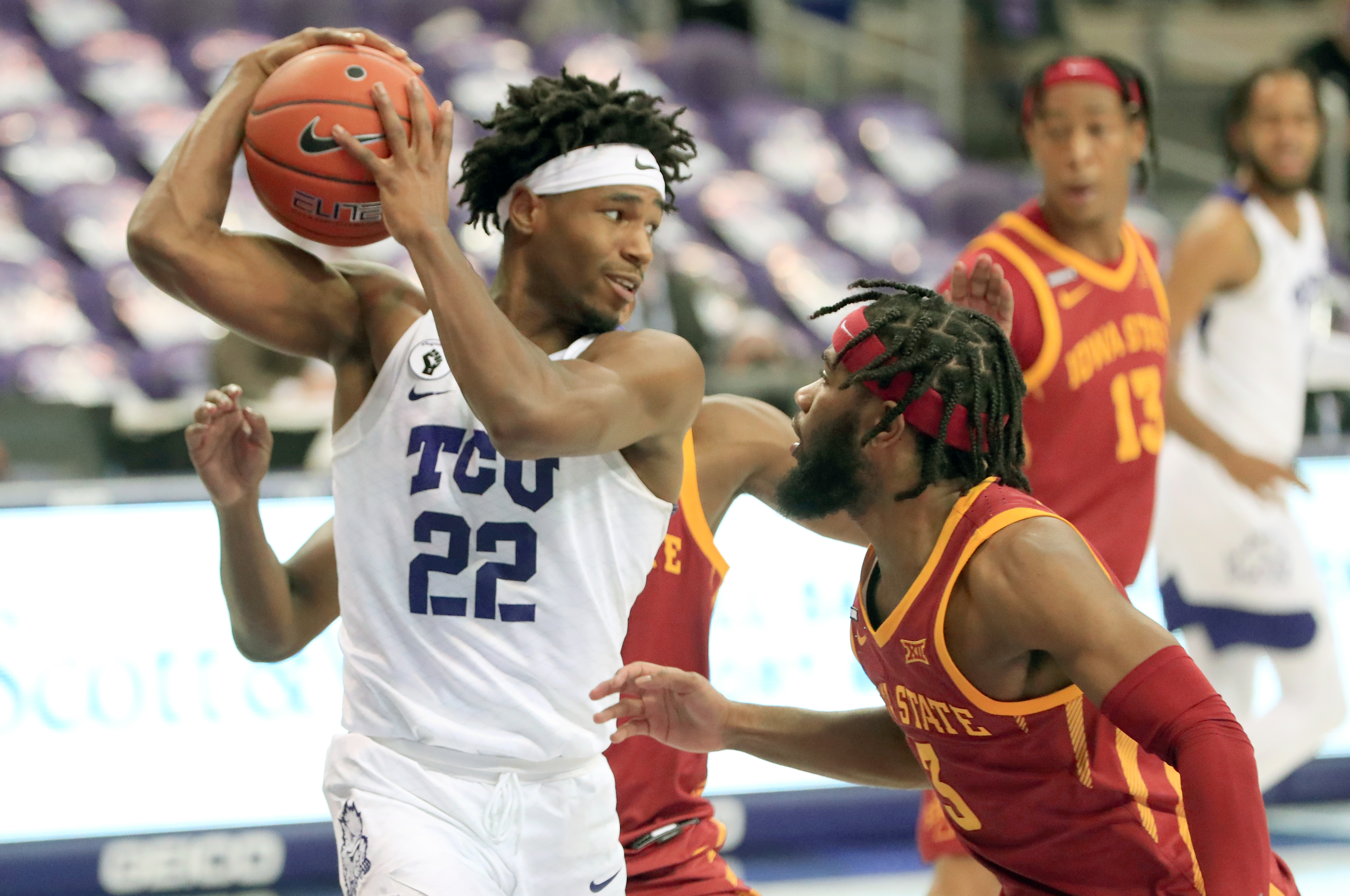 Feb 9, 2021; Fort Worth, Texas, USA; TCU Horned Frogs guard RJ Nembhard (22) looks to pass as Iowa State Cyclones guard Tre Jackson (3) defends during the second half at Ed and Rae Schollmaier Arena.
