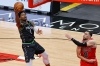 Feb 24, 2021; Chicago, Illinois, USA; Minnesota Timberwolves forward Anthony Edwards (1) goes to the basket past Chicago Bulls guard Zach LaVine (8) during the second half of an NBA game at United Center.