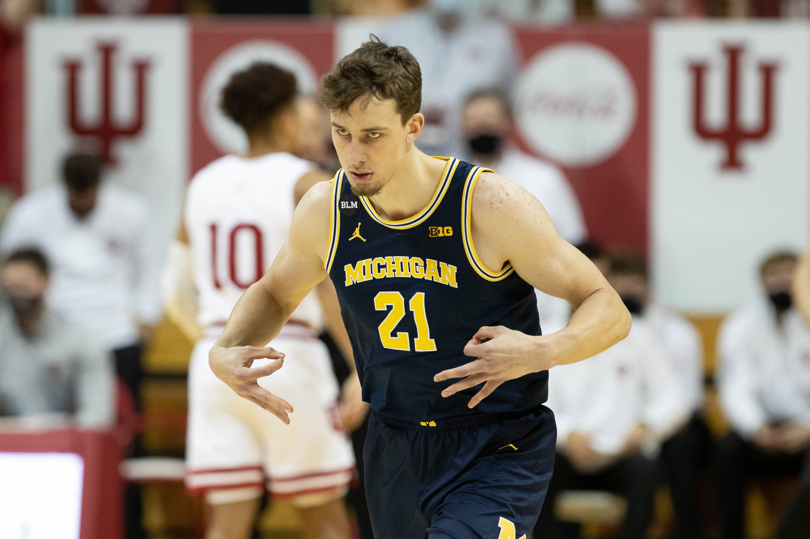 Feb 27, 2021; Bloomington, Indiana, USA; Michigan Wolverines guard Franz Wagner (21) celebrates a made three point basket in the first half against the Indiana Hoosiers at Simon Skjodt Assembly Hall.