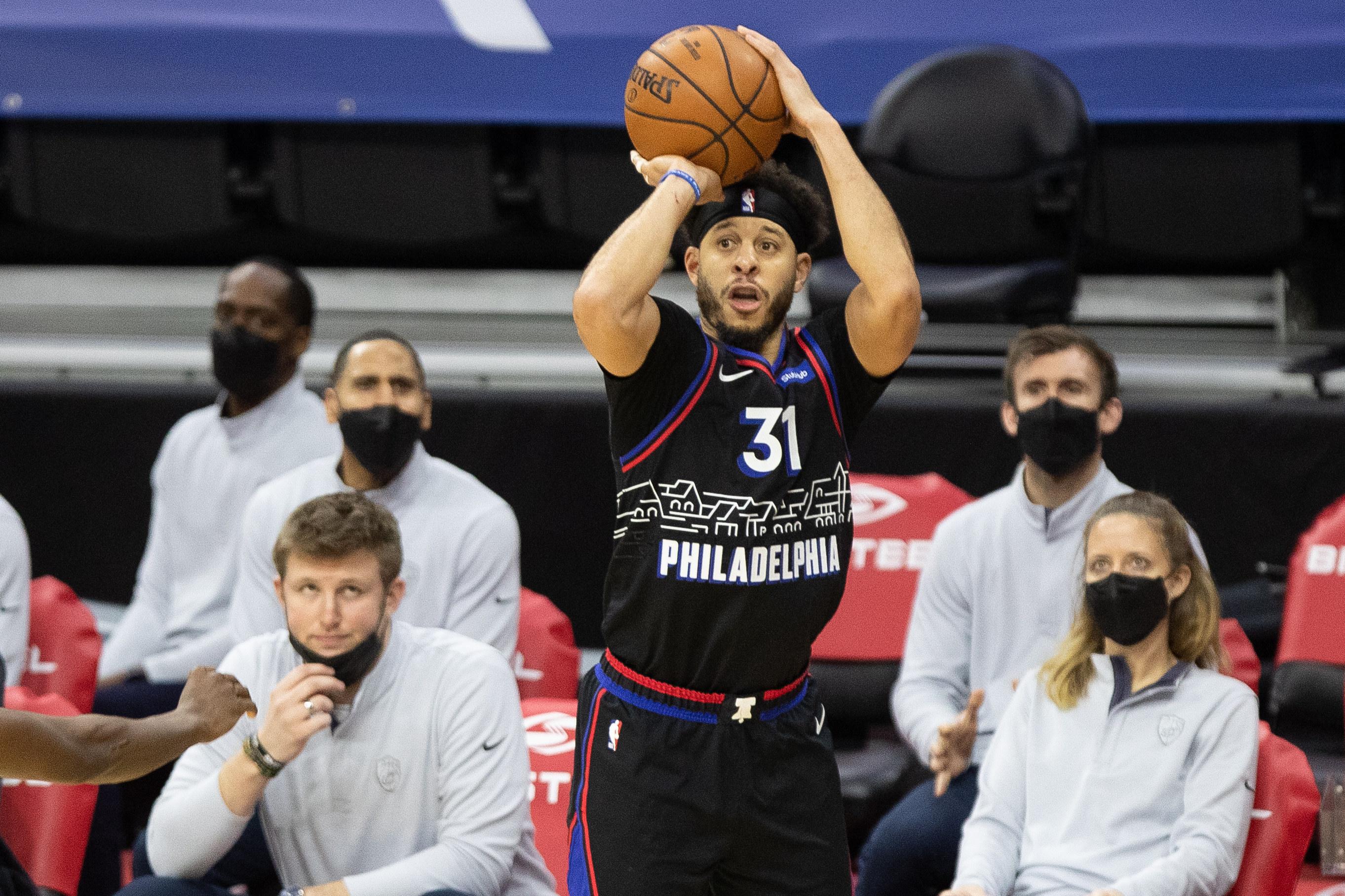 Feb 27, 2021; Philadelphia, Pennsylvania, USA; Philadelphia 76ers guard Seth Curry (31) shoots against the Cleveland Cavaliers during the third quarter at Wells Fargo Center.