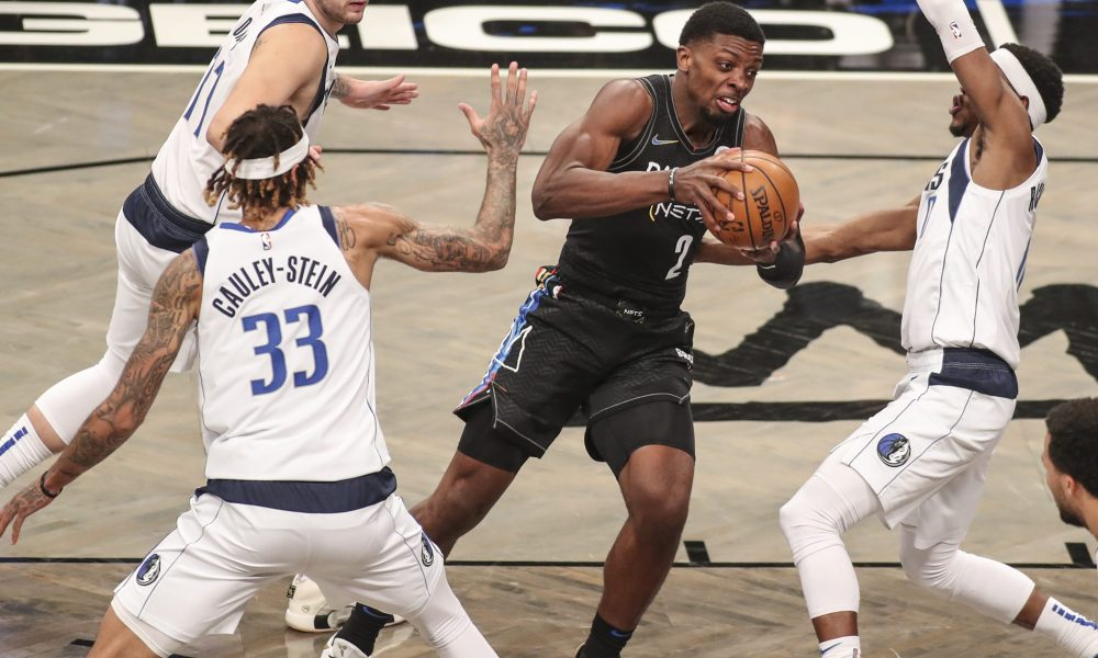 Feb 27, 2021; Brooklyn, New York, USA; Brooklyn Nets forward Tyler Cook (2) fights through a double team in the fourth quarter against the Dallas Mavericks at Barclays Center. Mandatory Credit: