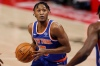 Feb 28, 2021; Detroit, Michigan, USA; New York Knicks guard Immanuel Quickley (5) drives to the basket against the Detroit Pistons during the second quarter at Little Caesars Arena.
