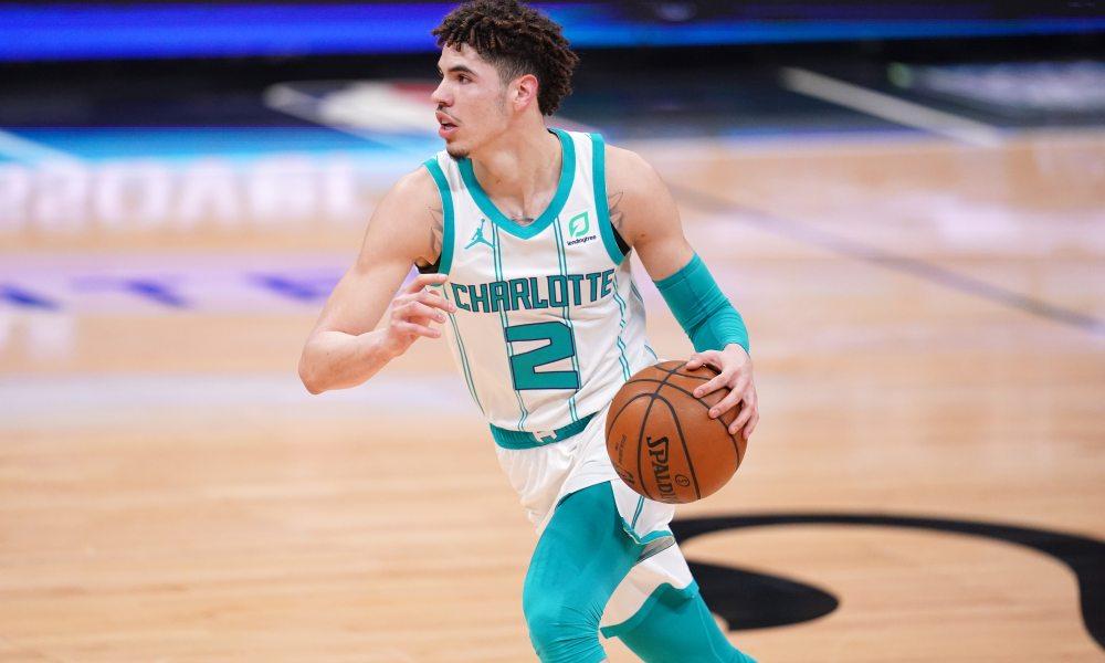 Feb 28, 2021; Sacramento, California, USA; Charlotte Hornets guard LaMelo Ball (2) dribbles the ball against the Sacramento Kings in the first quarter at the Golden 1 Center.