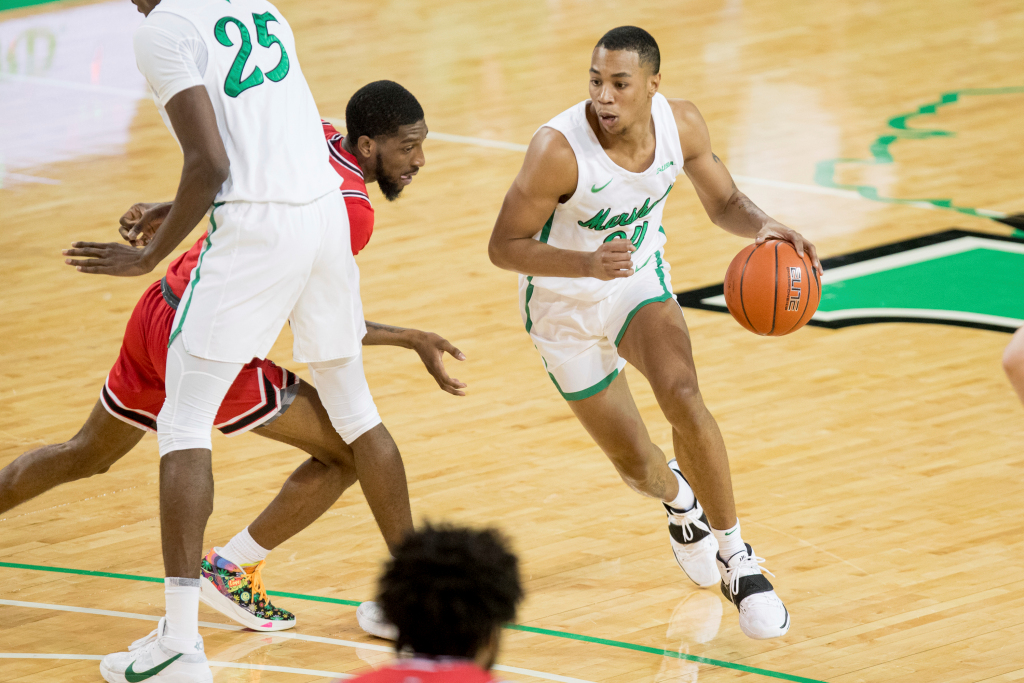 Marshall's Taevion Kinsey (24) works off of a screen by teammate Obinna Anochili-Killen (25) during an NCAA college basketball game against Western Kentucky on Sunday, Jan. 17, 2021, in Huntington, W.Va.