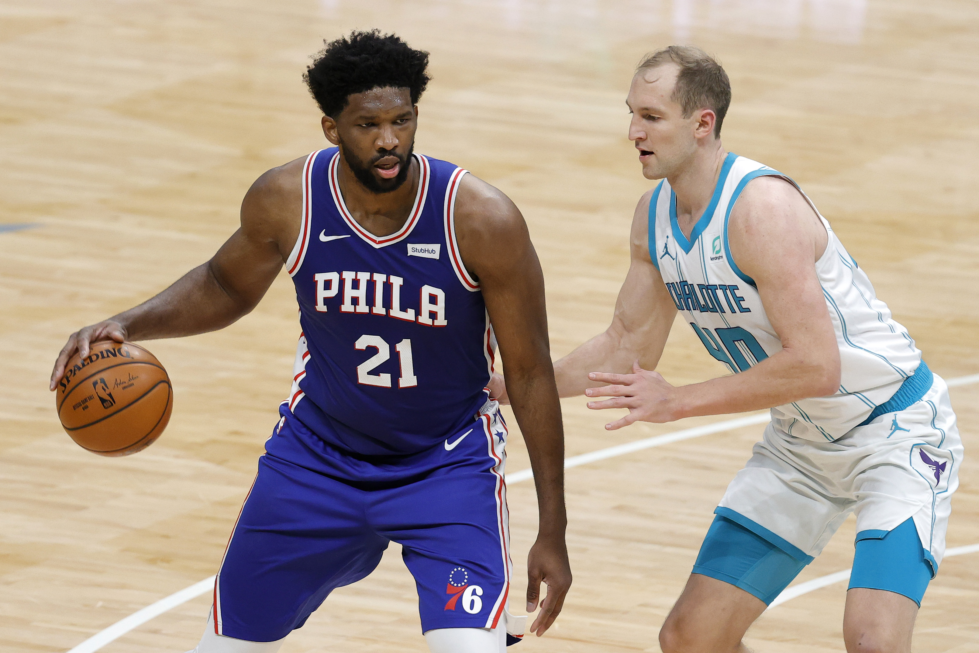 CHARLOTTE, NORTH CAROLINA - FEBRUARY 03: Joel Embiid #21 of the Philadelphia 76ers posts up against Cody Zeller #40 of the Charlotte Hornets during the second quarter of their game against the Charlotte Hornets at Spectrum Center on February 03, 2021 in Charlotte, North Carolina. NOTE TO USER: User expressly acknowledges and agrees that, by downloading and or using this photograph, User is consenting to the terms and conditions of the Getty Images License Agreement.