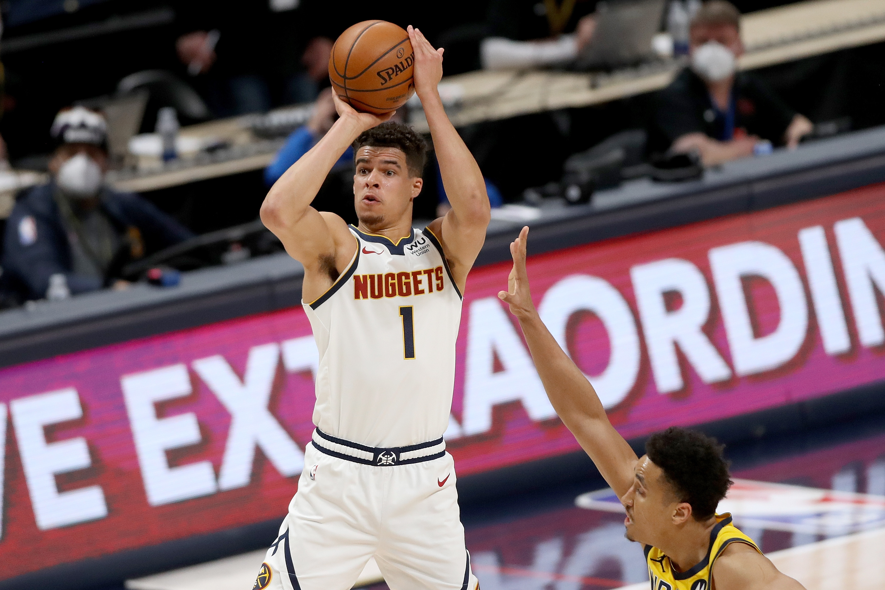DENVER, COLORADO - MARCH 15: Michael Porter Jr. #1 of the Denver Nuggets puts up a shot over Malcolm Brogdon #7 of the Indiana Pacers in the second period at Ball Arena on March 15, 2021 in Denver, Colorado. NOTE TO USER: User expressly acknowledges and agrees that, by downloading and or using this photograph, User is consenting to the terms and conditions of the Getty Images License Agreement.