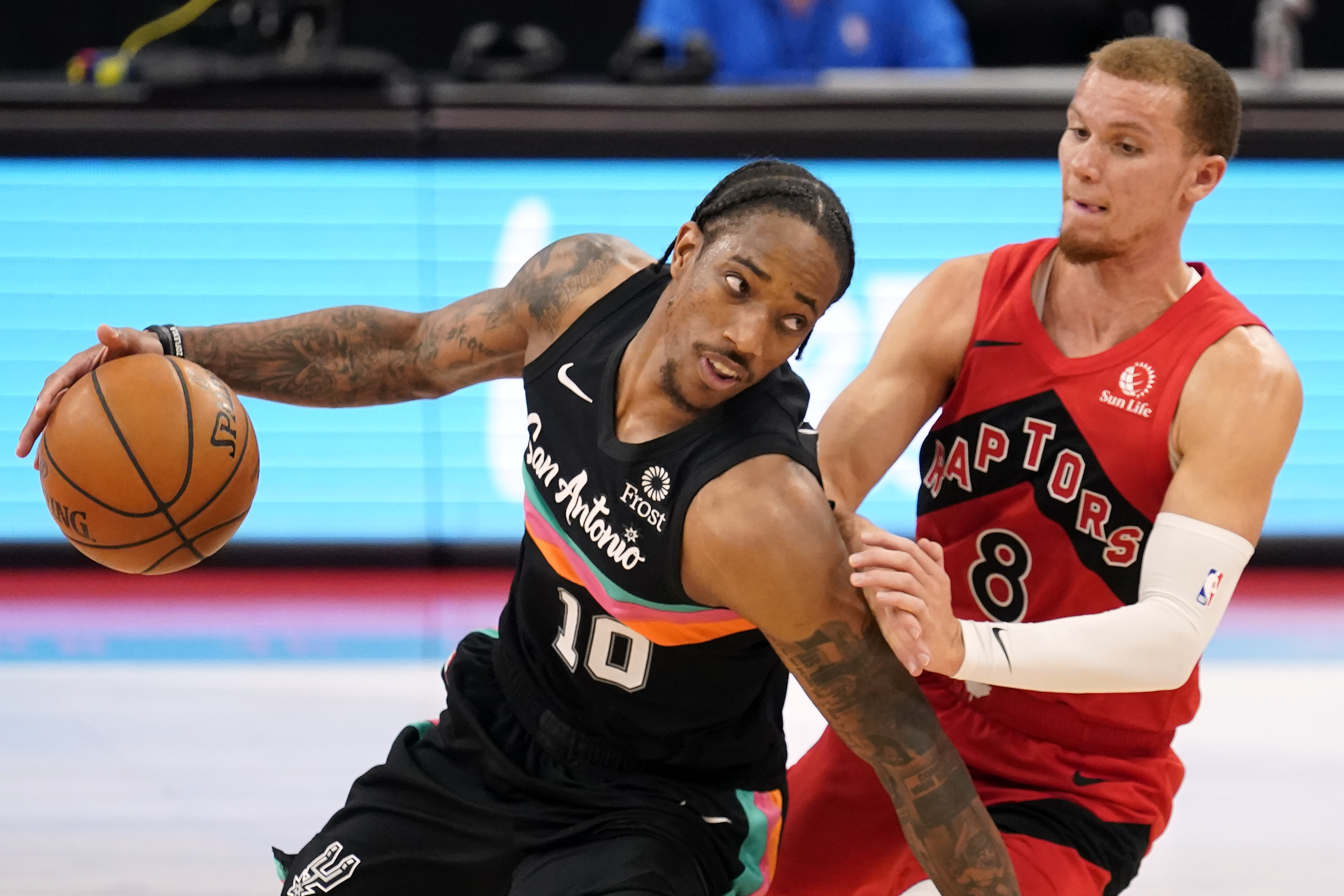 San Antonio Spurs forward DeMar DeRozan (10) drives around Toronto Raptors guard Malachi Flynn (8) during the second half of an NBA basketball game Wednesday, April 14, 2021, in Tampa, Fla.