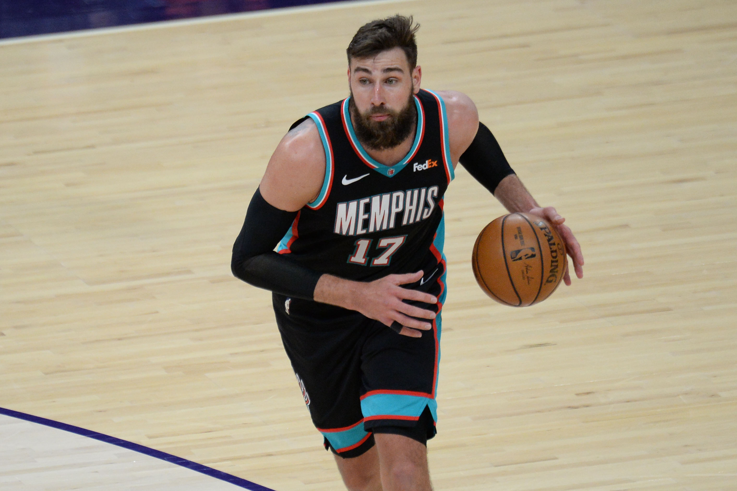Mar 15, 2021; Phoenix, Arizona, USA; Memphis Grizzlies center Jonas Valanciunas (17) dribbles the ball against the Phoenix Suns during the second half at Phoenix Suns Arena.