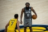 Mar 17, 2021; Indianapolis, Indiana, USA; Brooklyn Nets guard James Harden (13) dribbles the ball while Indiana Pacers guard Malcolm Brogdon (7) defends in the third quarter at Bankers Life Fieldhouse.