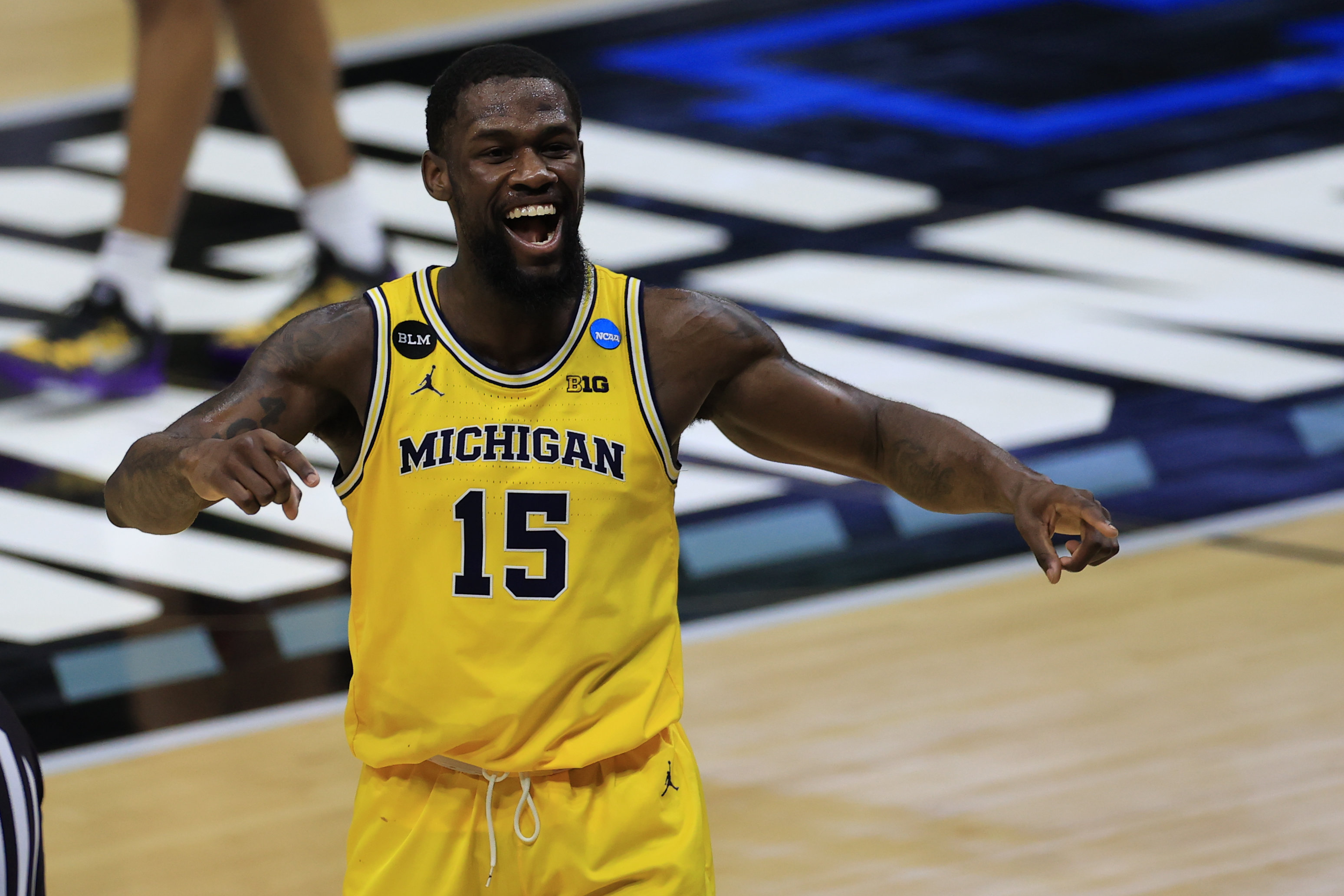 Mar 22, 2021; Indianapolis, Indiana, USA; Michigan Wolverines guard Chaundee Brown (15) celebrates after the game in the second round of the 2021 NCAA Tournament against the Louisiana State Tigers at Lucas Oil Stadium.