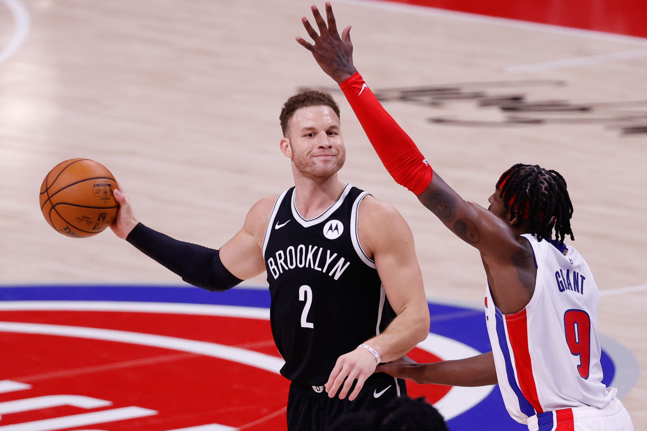 Mar 26, 2021; Detroit, Michigan, USA; Brooklyn Nets forward Blake Griffin (2) is defended by Detroit Pistons forward Jerami Grant (9) in the second half at Little Caesars Arena.
