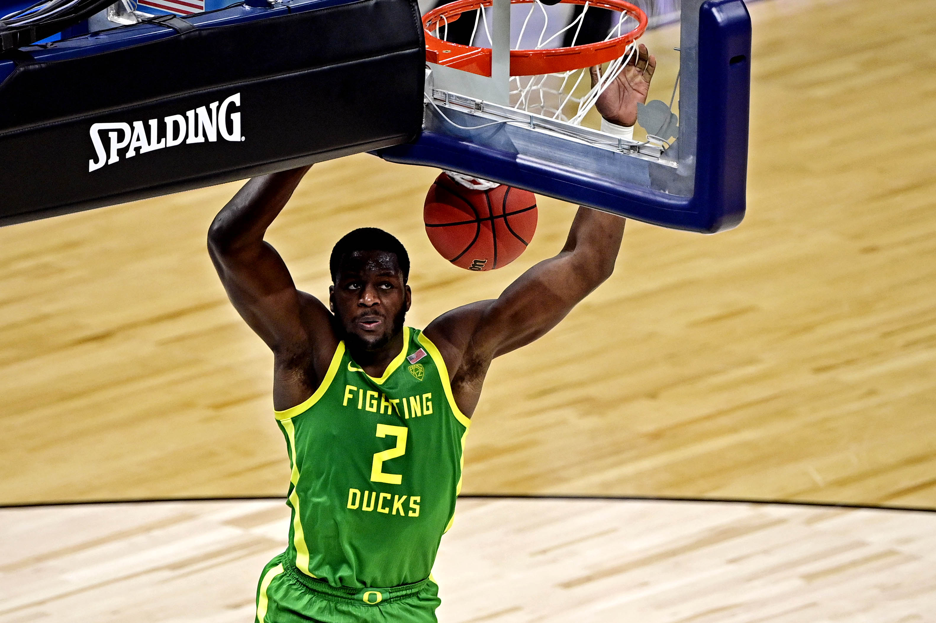 Mar 28, 2021; Indianapolis, Indiana, USA; Oregon Ducks forward Eugene Omoruyi (2) dunks the ball during the first half against the USC Trojans in the Sweet Sixteen of the 2021 NCAA Tournament at Bankers Life Fieldhouse.
