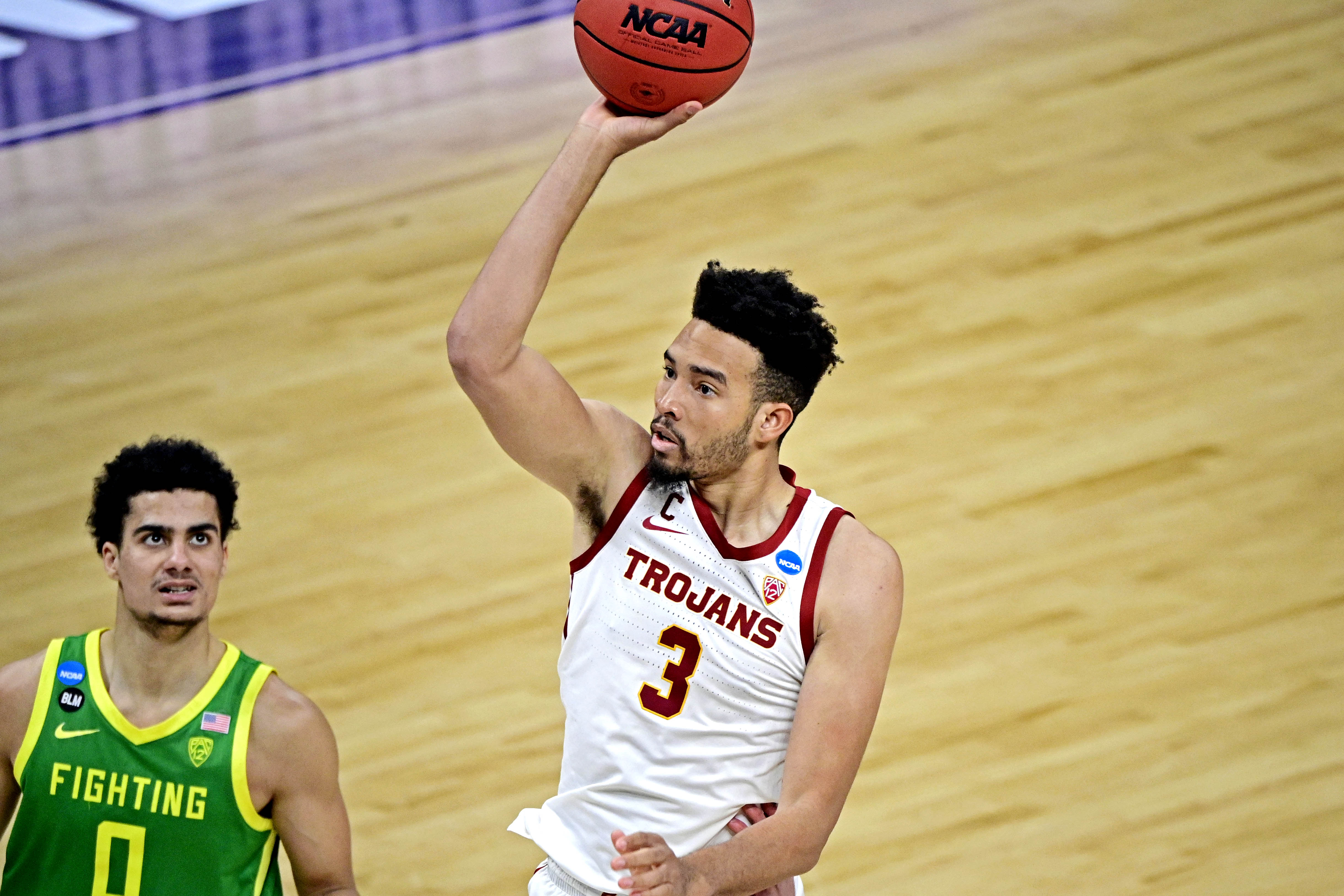 Mar 28, 2021; Indianapolis, Indiana, USA; USC Trojans forward Isaiah Mobley (3) shoots the ball against Oregon Ducks guard Will Richardson (0) during the second half in the Sweet Sixteen of the 2021 NCAA Tournament at Bankers Life Fieldhouse.