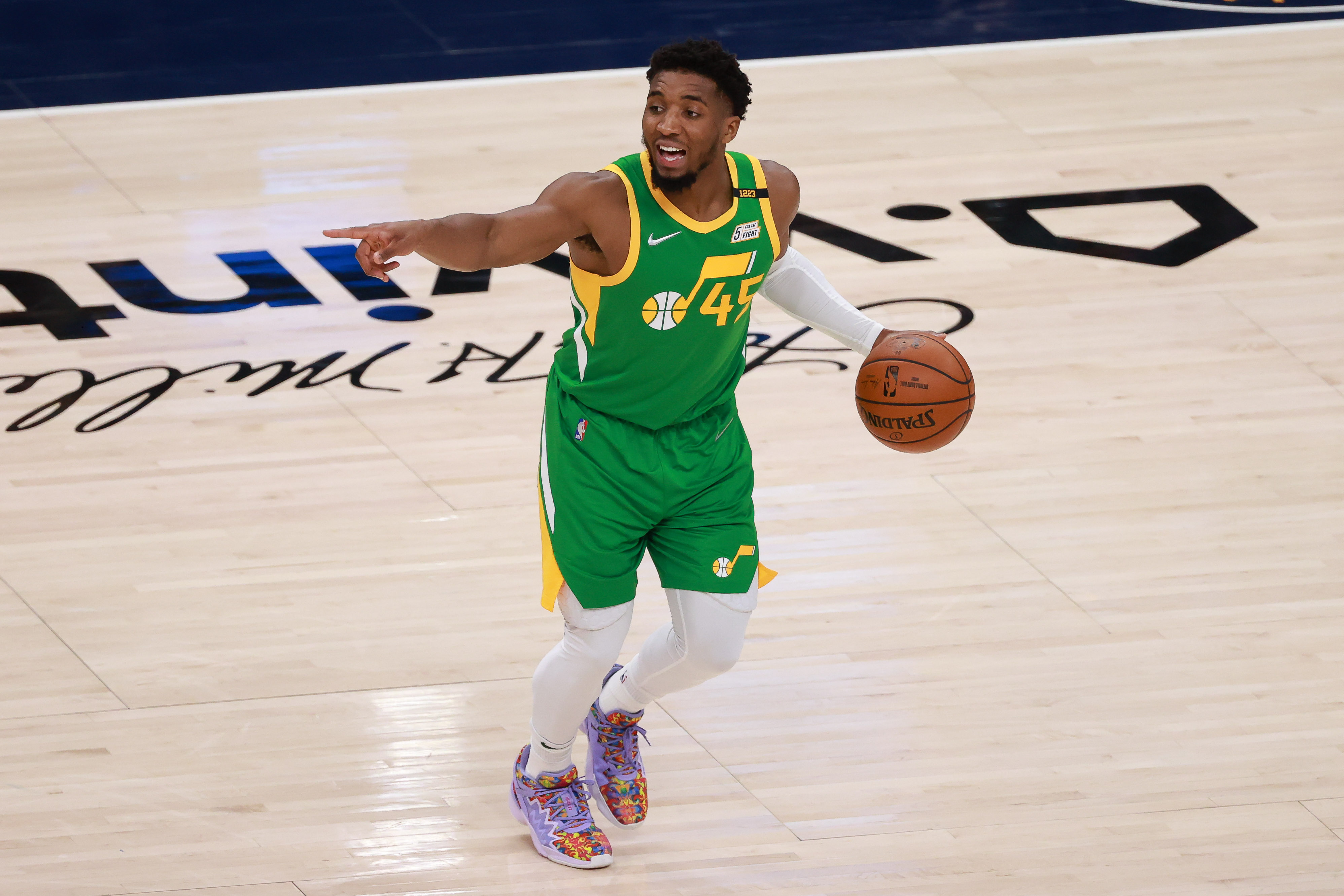 Apr 8, 2021; Salt Lake City, Utah, USA; Utah Jazz guard Donovan Mitchell (45) gestures as he dribbles the ball against the Portland Trail Blazers during the third quarter at Vivint Smart Home Arena.