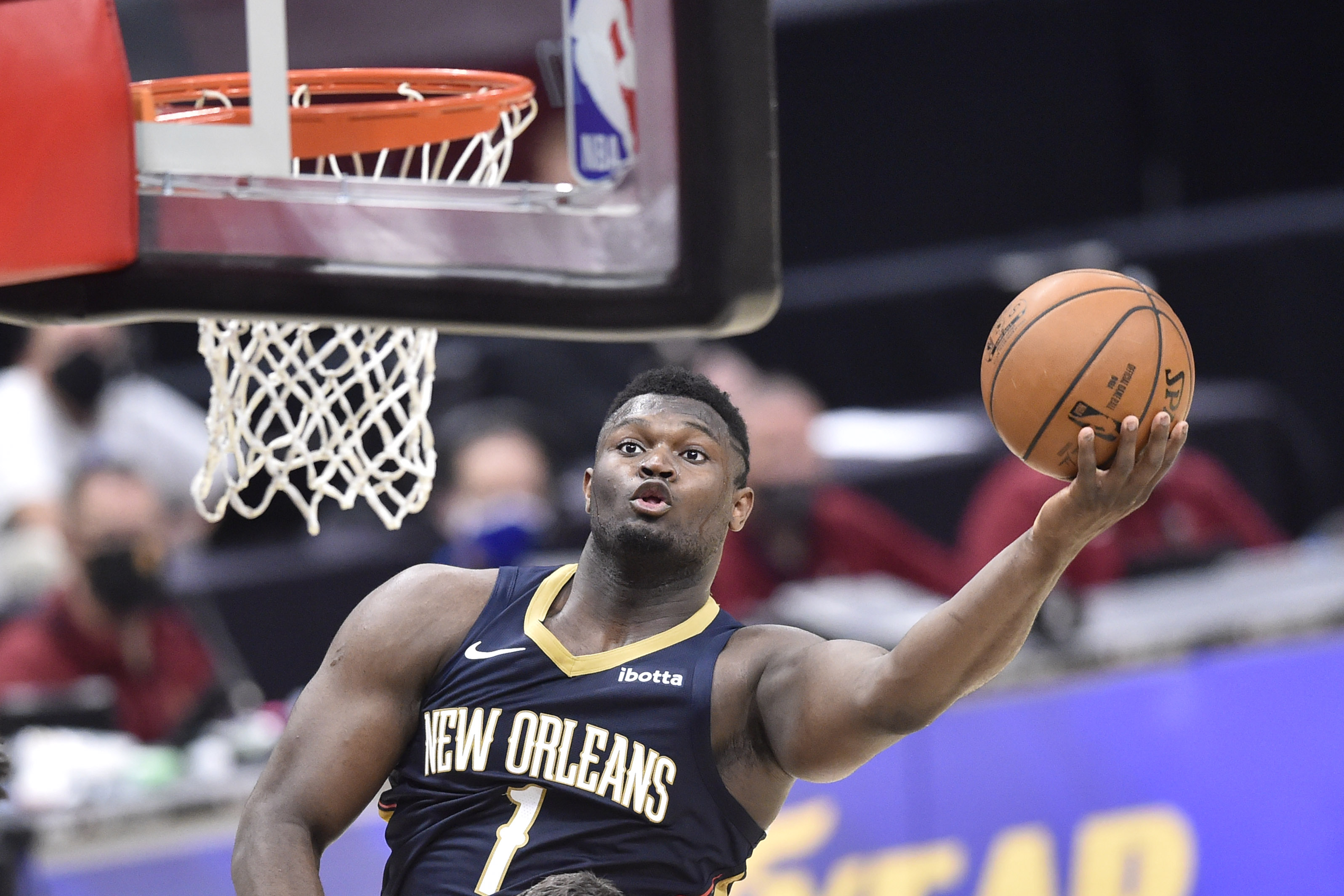 Apr 11, 2021; Cleveland, Ohio, USA; New Orleans Pelicans forward Zion Williamson (1) goes to the basket during the fourth quarter against the Cleveland Cavaliers at Rocket Mortgage FieldHouse.