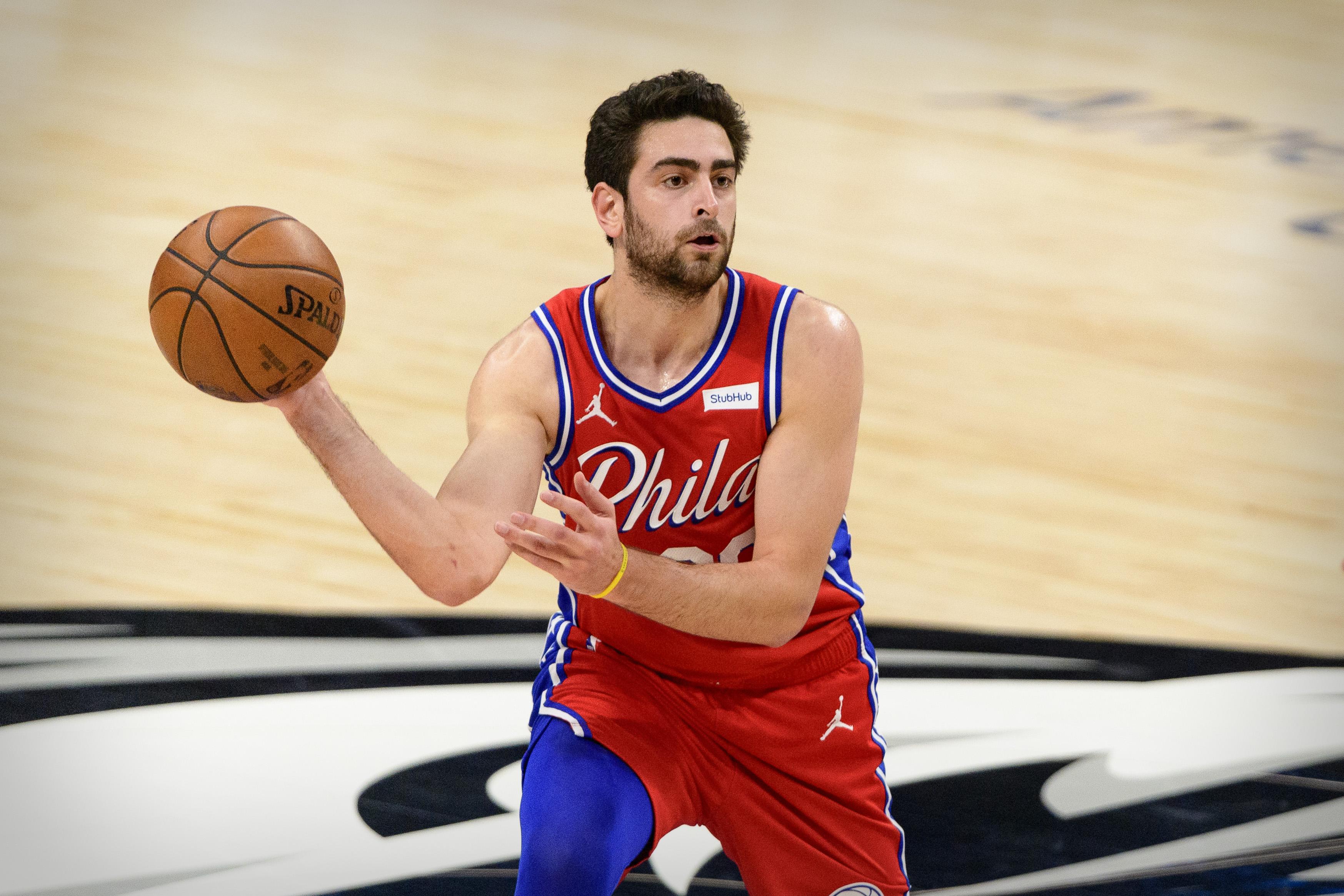 Apr 12, 2021; Dallas, Texas, USA; Philadelphia 76ers guard Furkan Korkmaz (30) passes the ball against the Dallas Mavericks during the second half at the American Airlines Center.