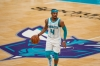 Apr 14, 2021; Charlotte, North Carolina, USA; Charlotte Hornets guard Devonte' Graham (4) handles the ball during the second half against the Cleveland Cavaliers at the Spectrum Center.