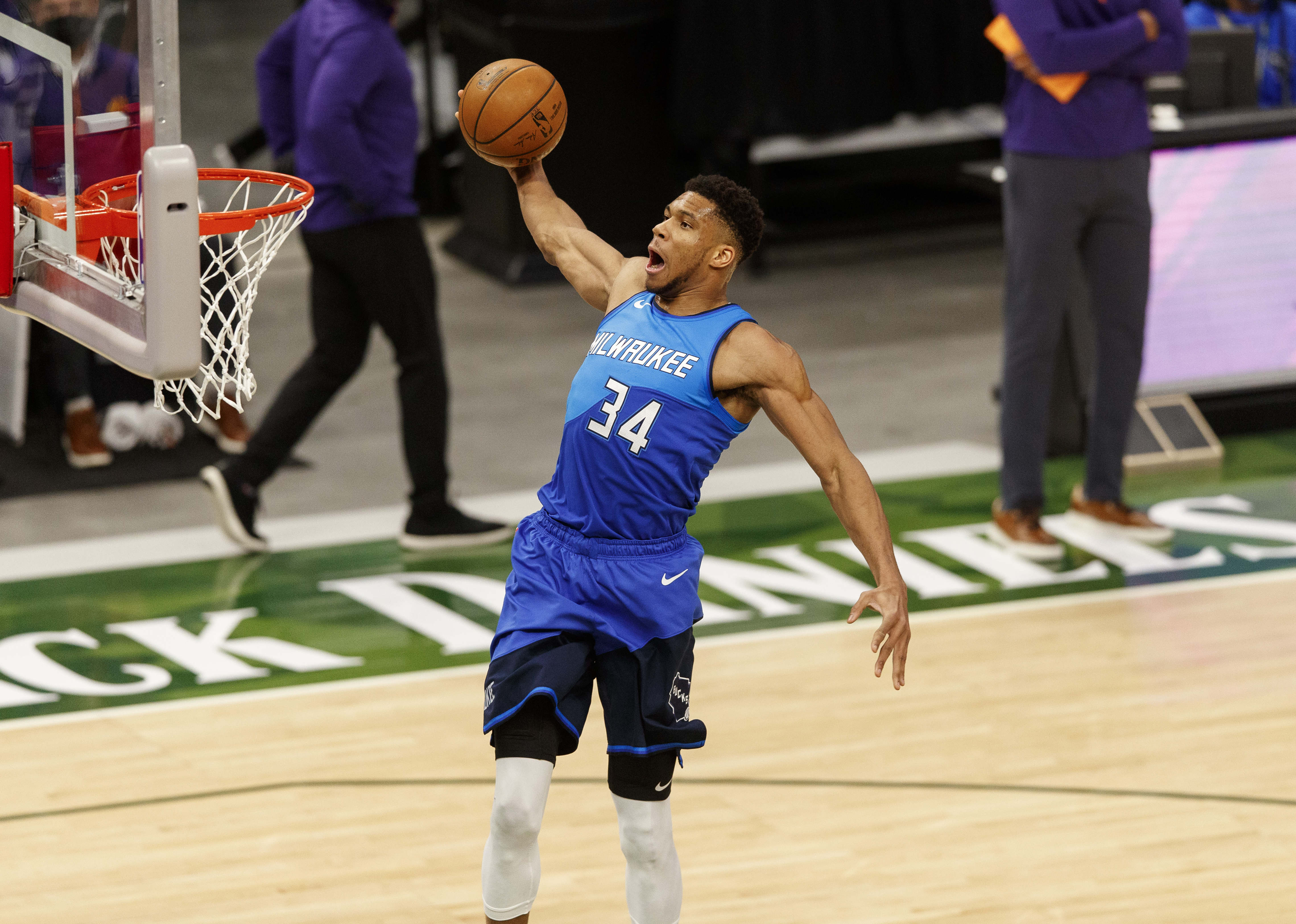 Apr 19, 2021; Milwaukee, Wisconsin, USA; Milwaukee Bucks forward Giannis Antetokounmpo (34) dunks during the first quarter against the Phoenix Suns at Fiserv Forum.