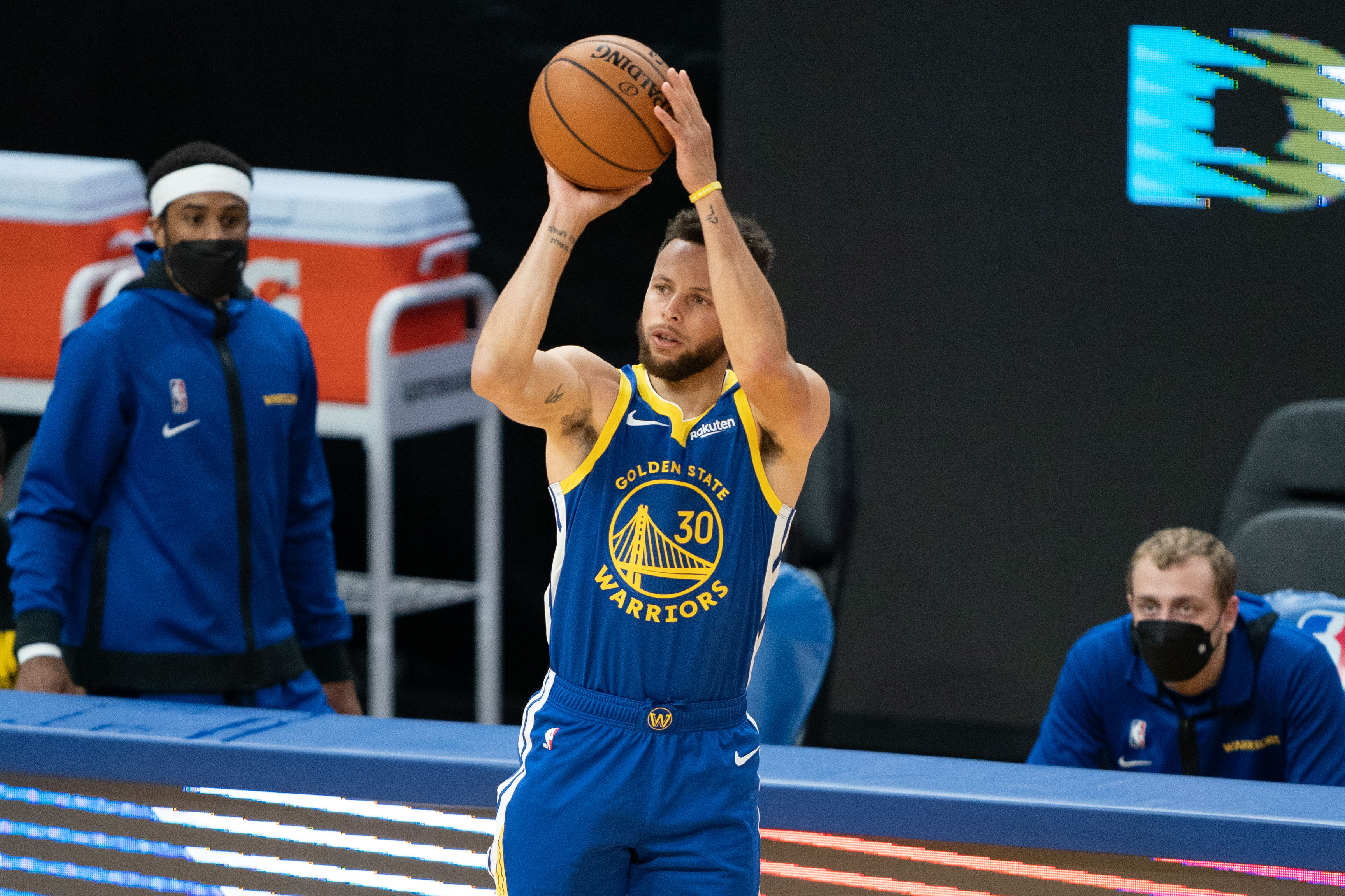 April 12, 2021; San Francisco, California, USA; Golden State Warriors guard Stephen Curry (30) shoots the basketball during the first quarter against the Denver Nuggets at Chase Center.